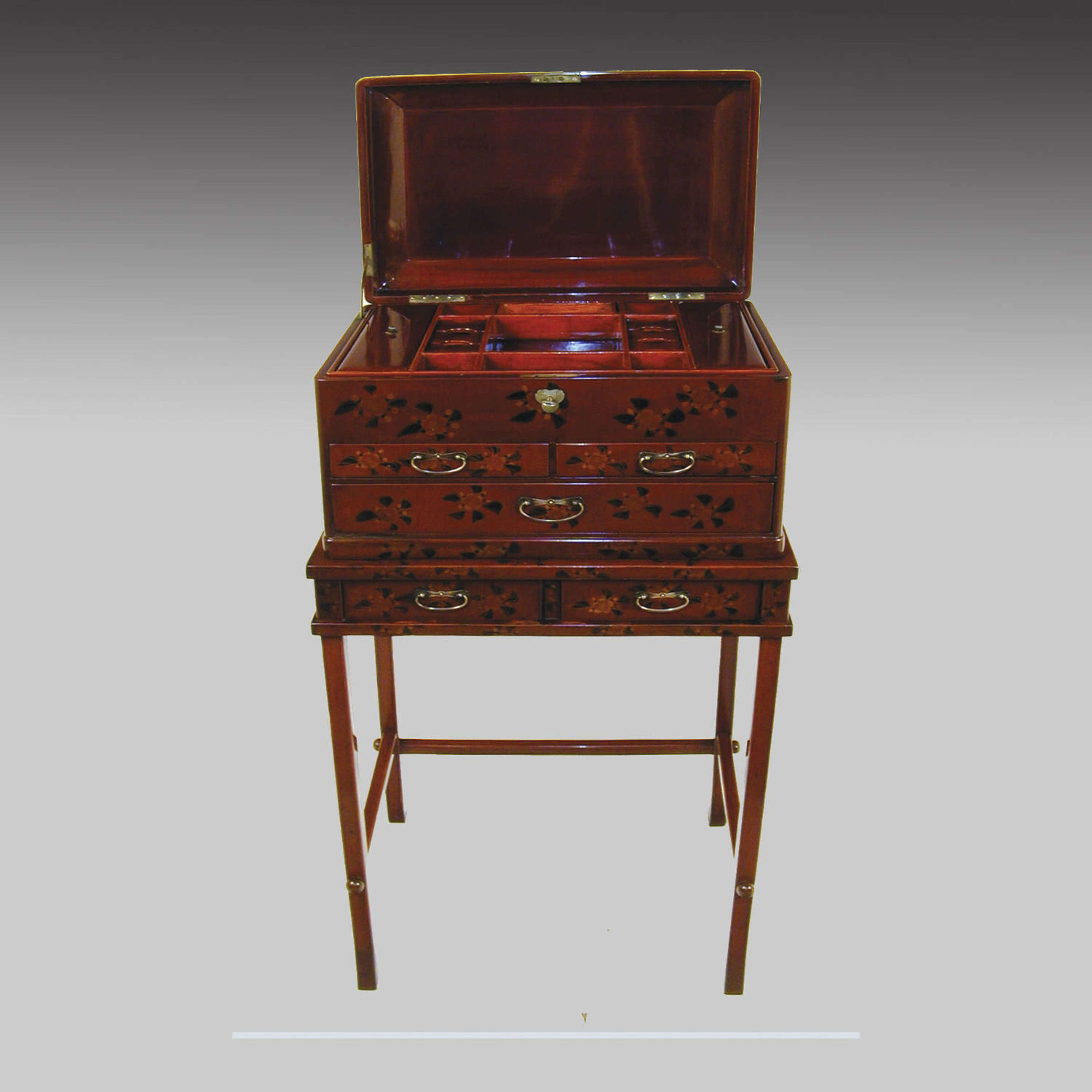 Anglo-Japanese red lacquer box on stand