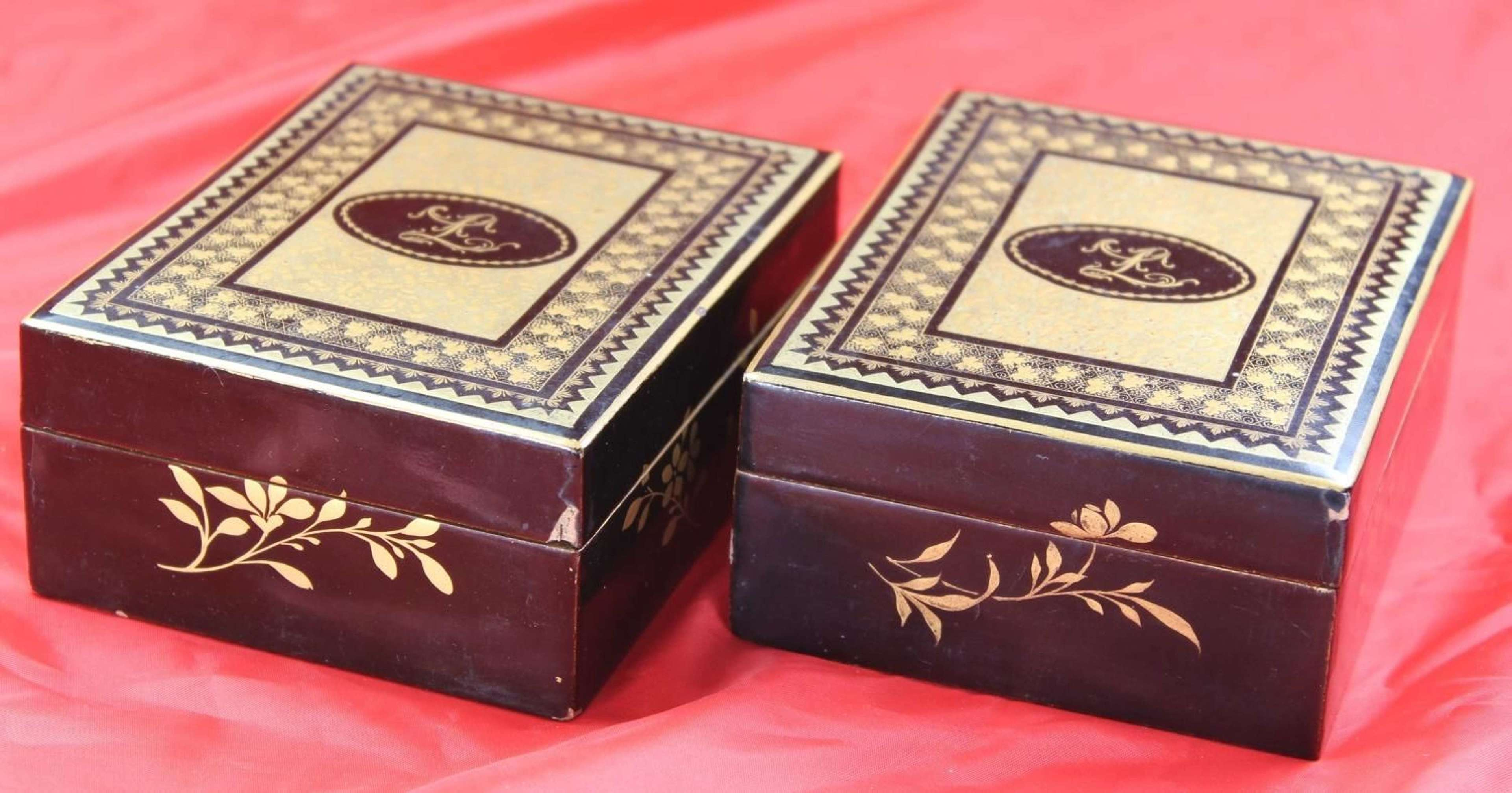 Two 19C lacquer boxes with matching 'L' mono counters