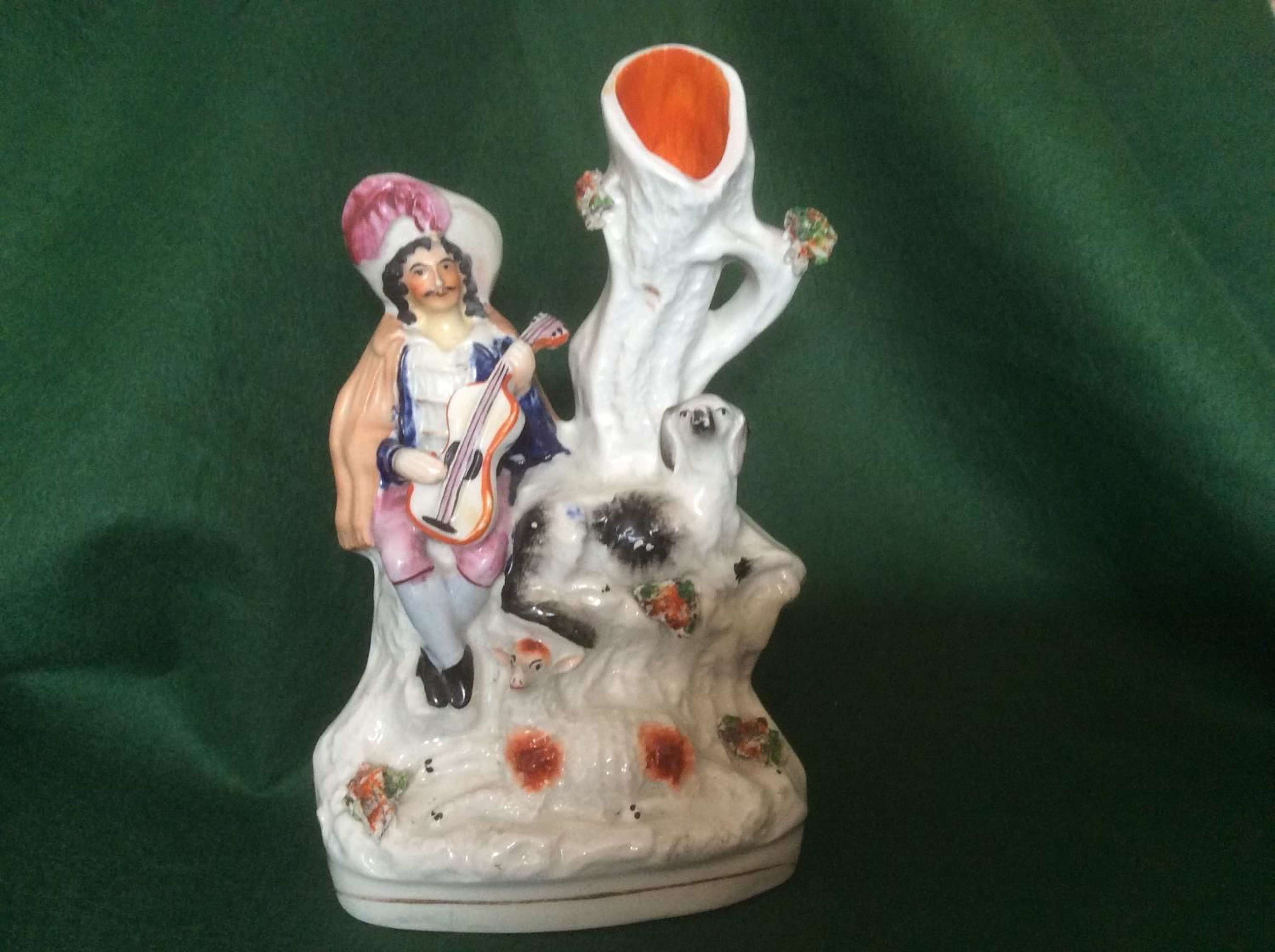 Staffordshire spill vase figure of a musician