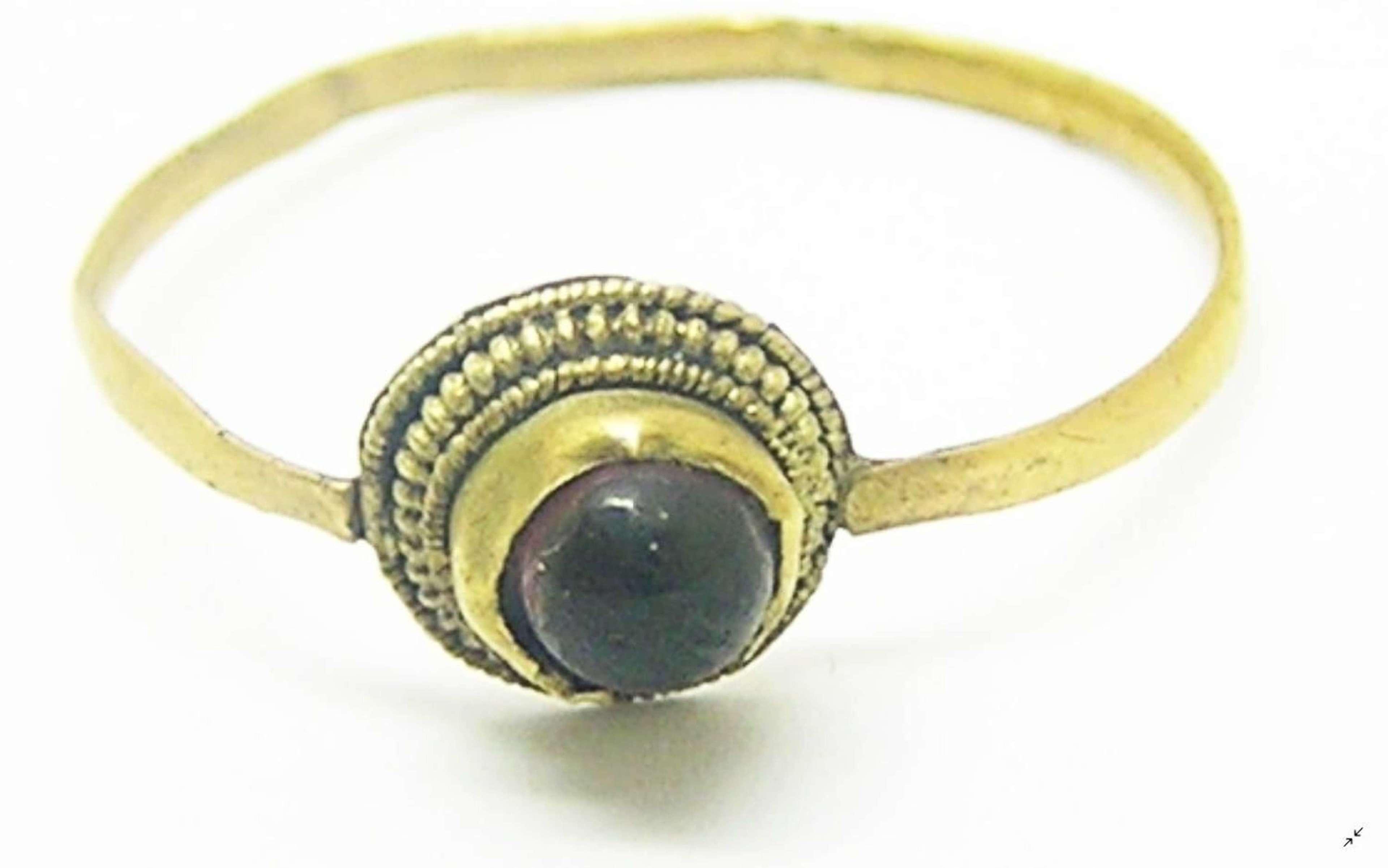 Medieval gold penny ring set with garnet gemstone