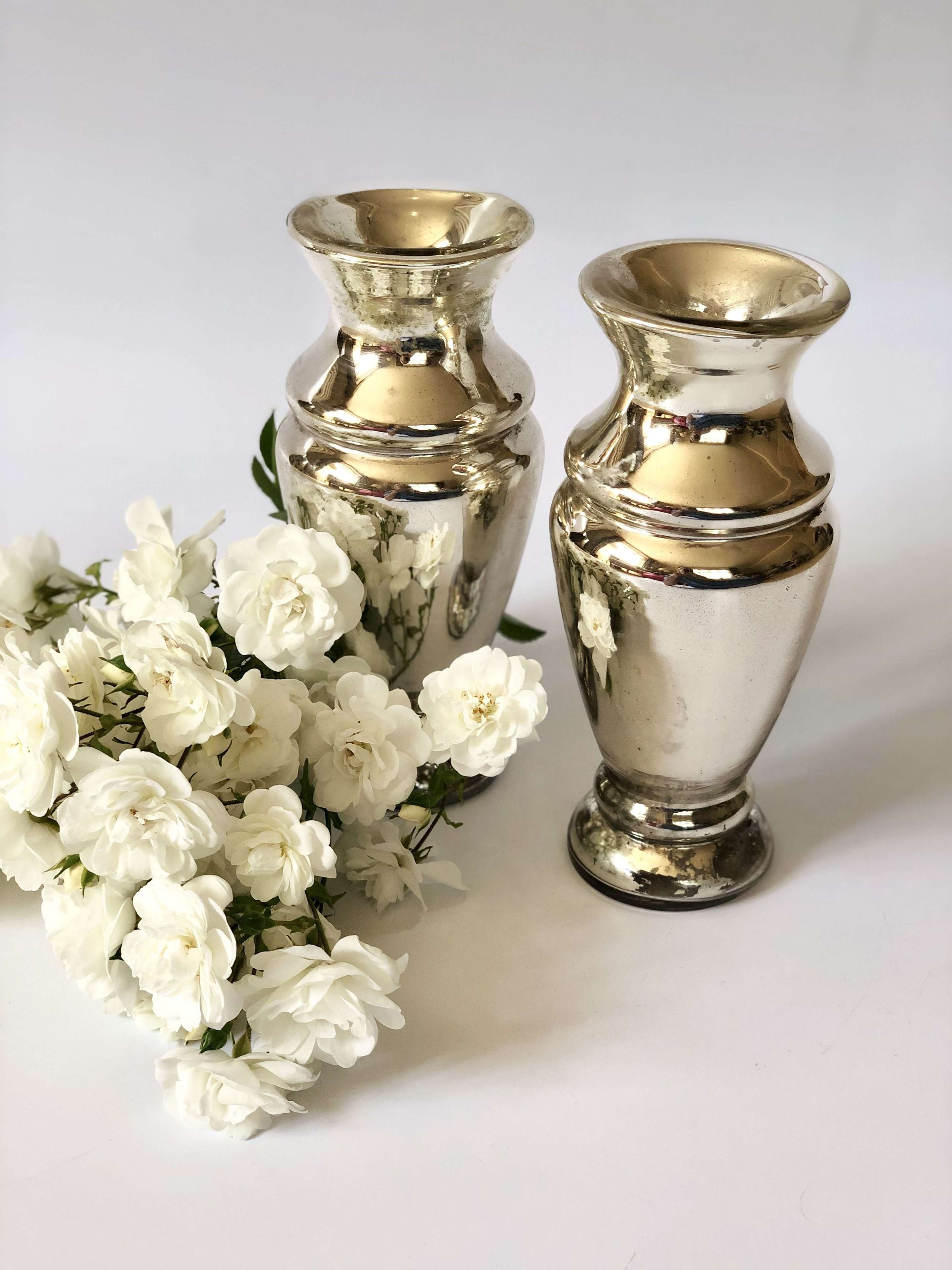Pair of Victorian Mercury foxed glass mirrored vases