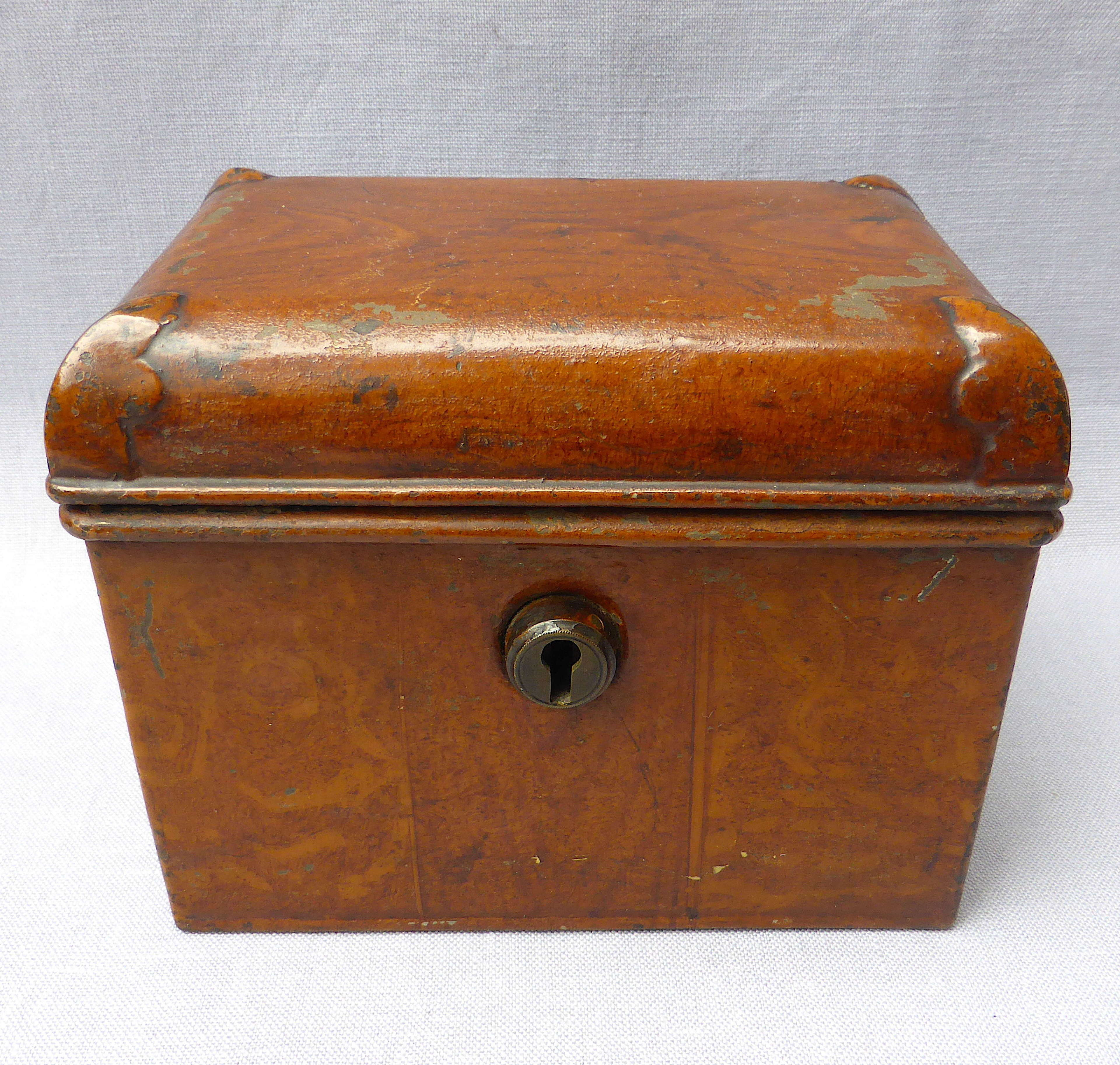 Doll's miniature tin trunk with wood grain finish