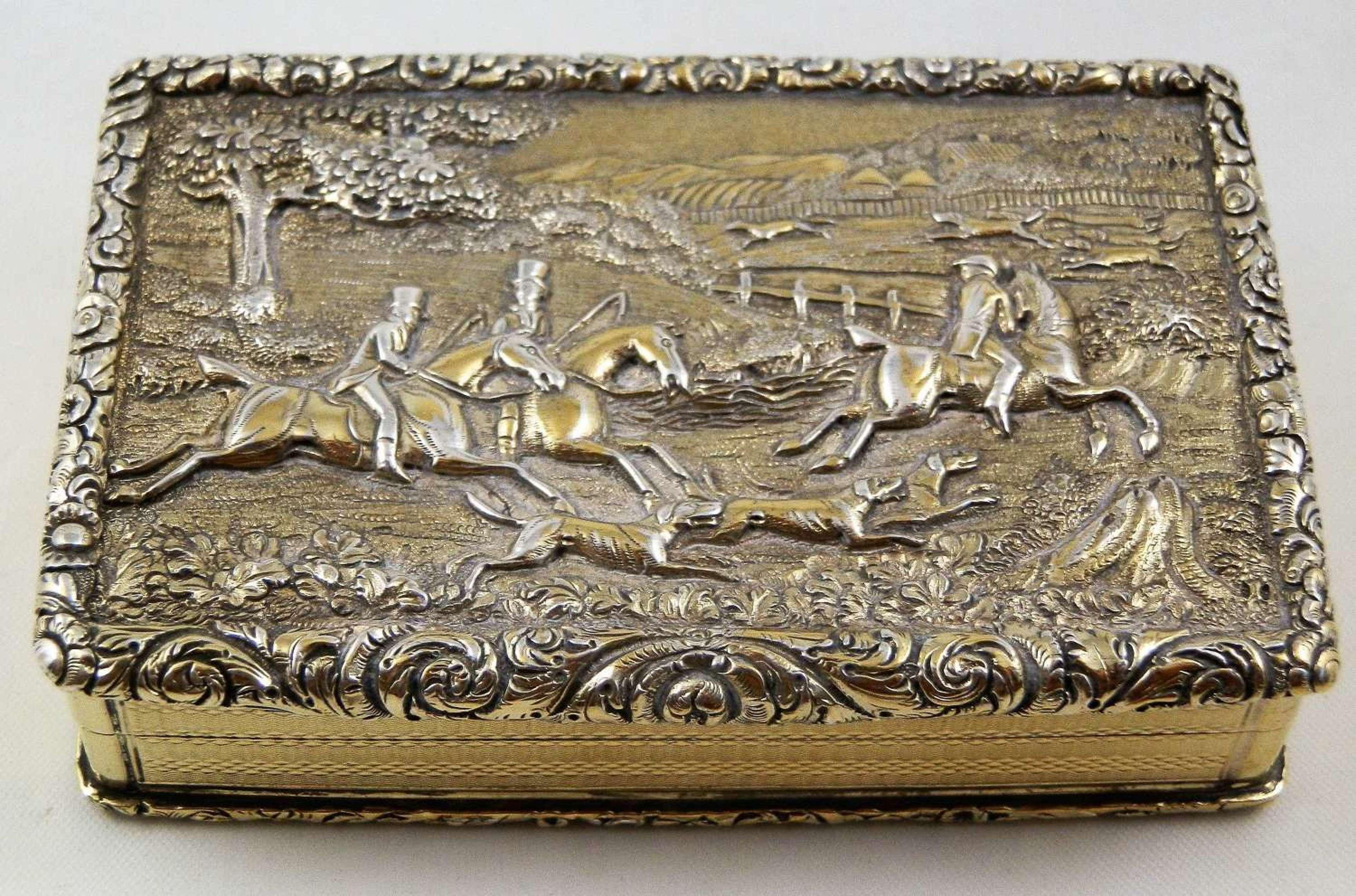 A George IV hunting scene silver gilt table snuff box, 1829
