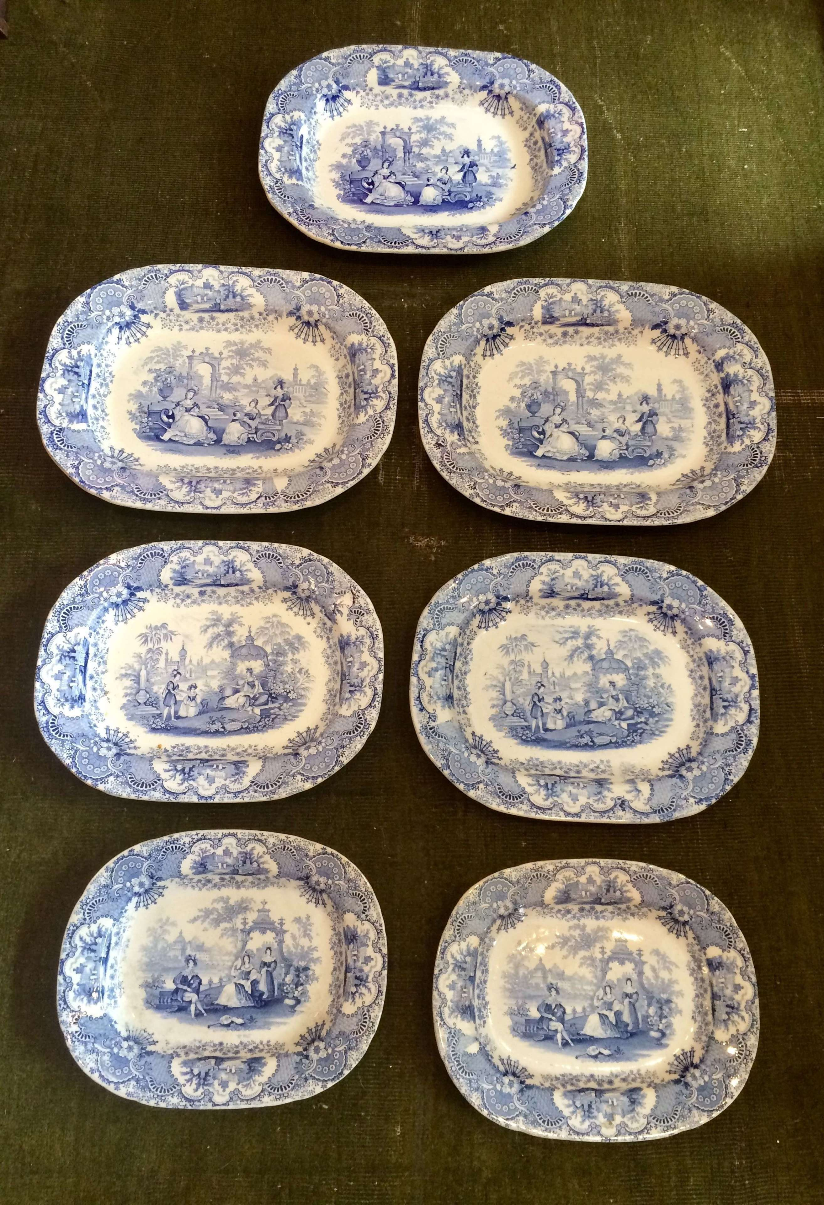 Set of 7 19th century blue and white transferware platters.