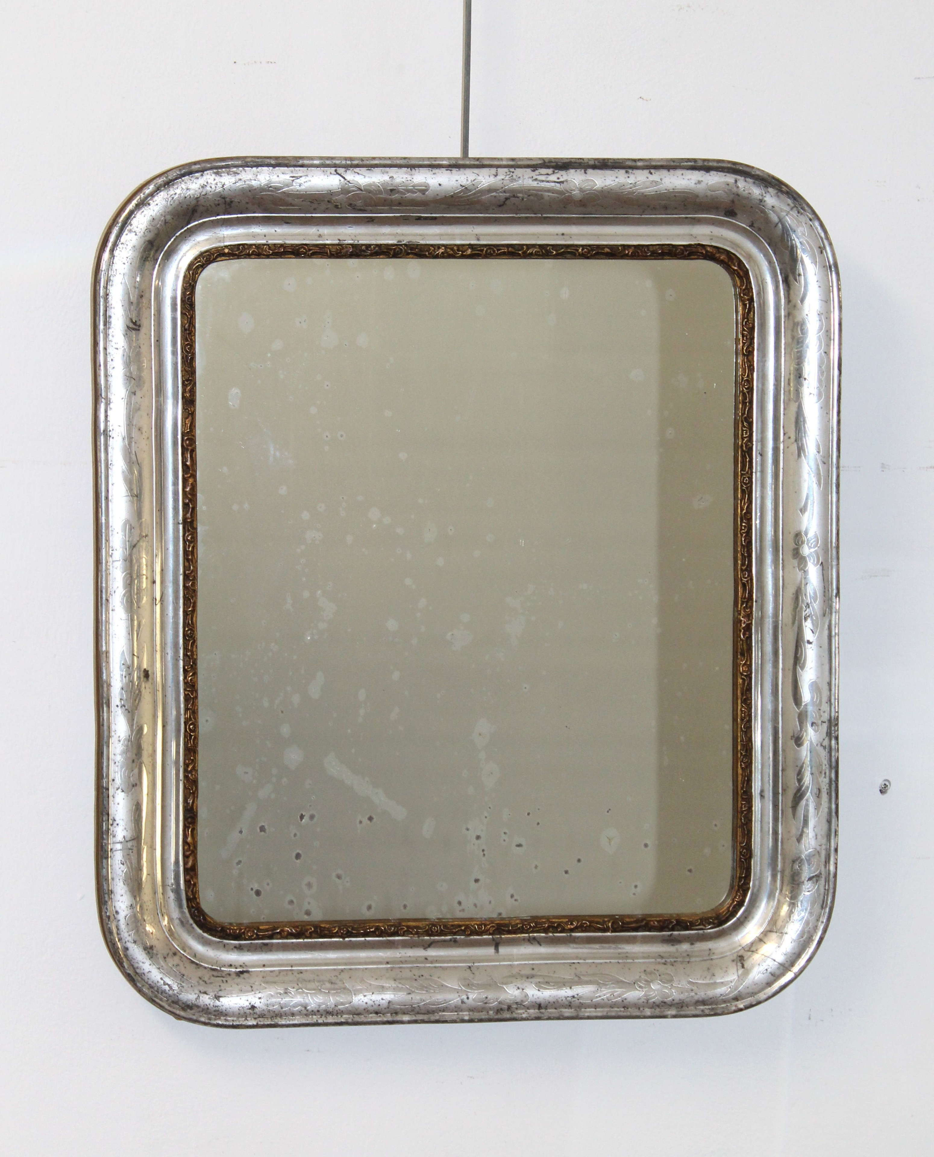 Antique silver leafed mirror with curved corners