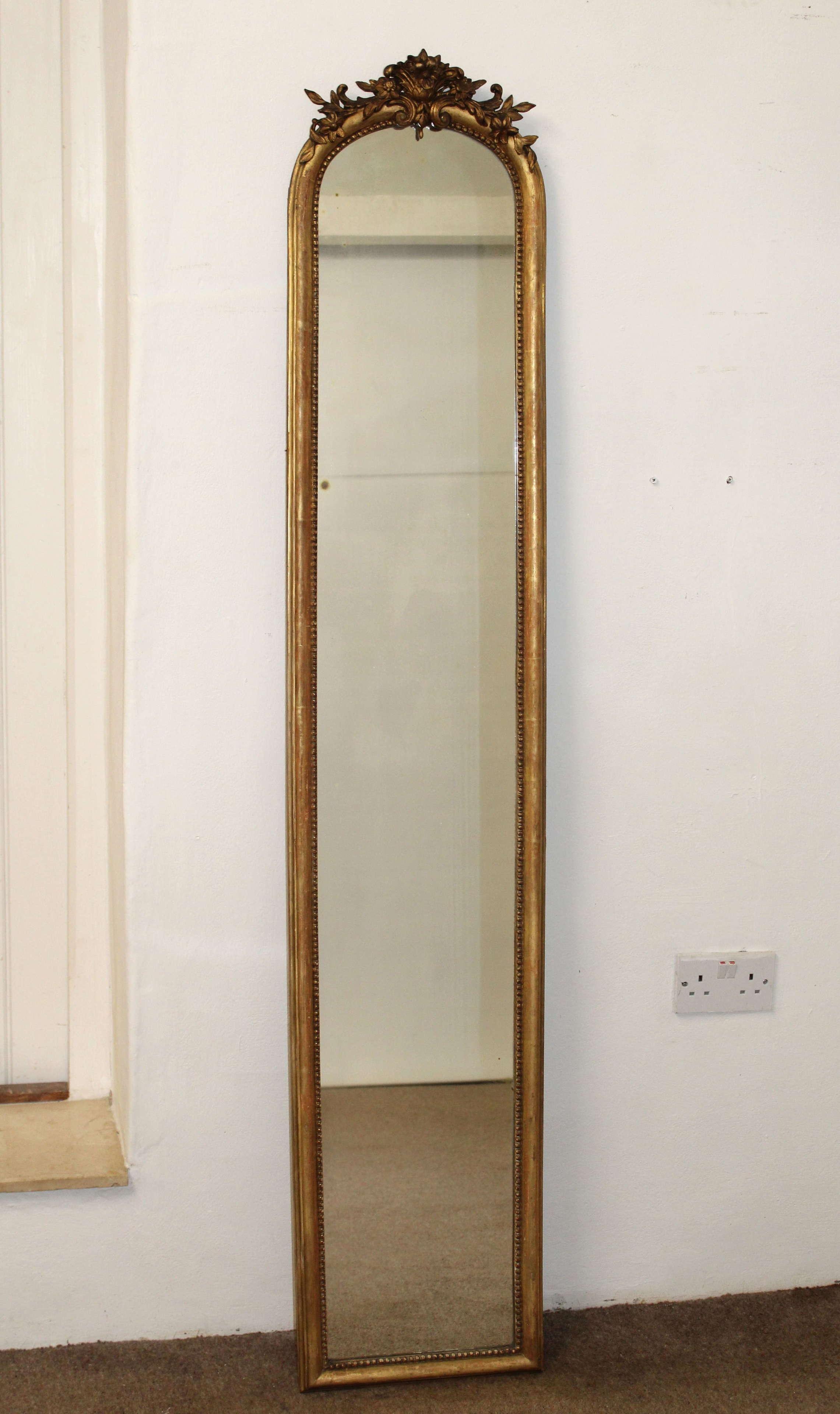 Tall, narrow, antique mirror with cartouche