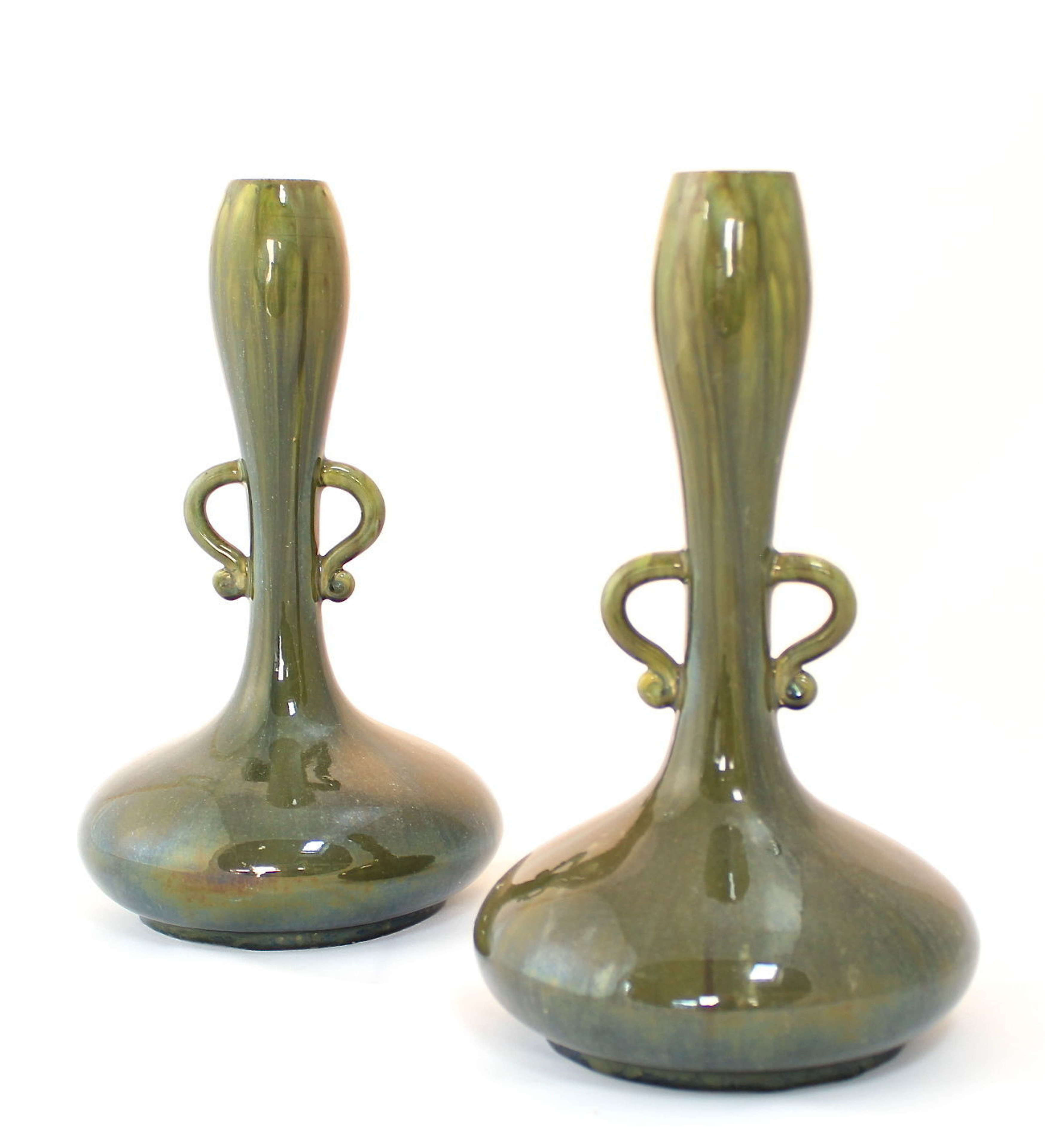 A pair of pottery Dresser style vases