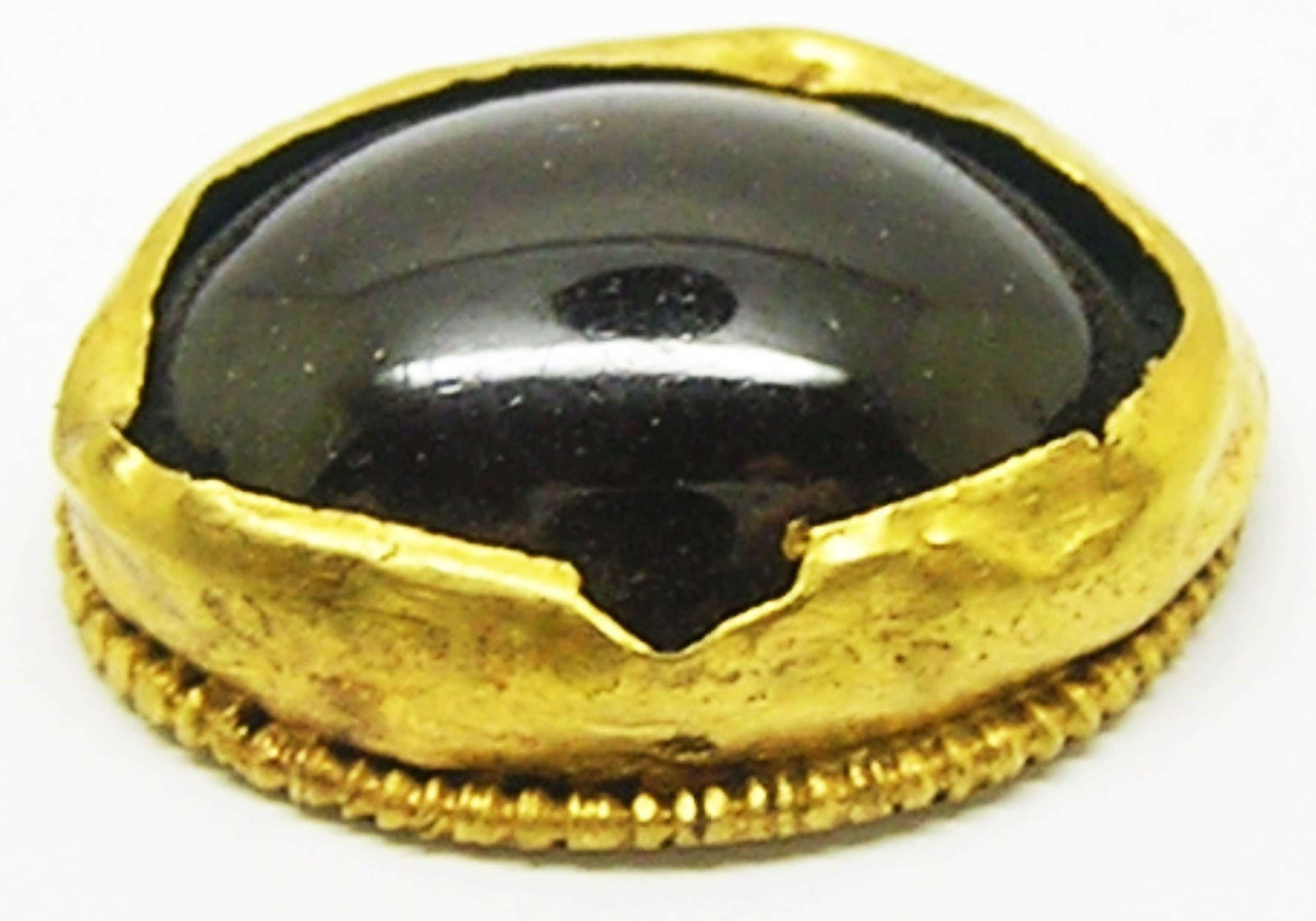 Merovingian Saxon period gold and garnet scabbard button