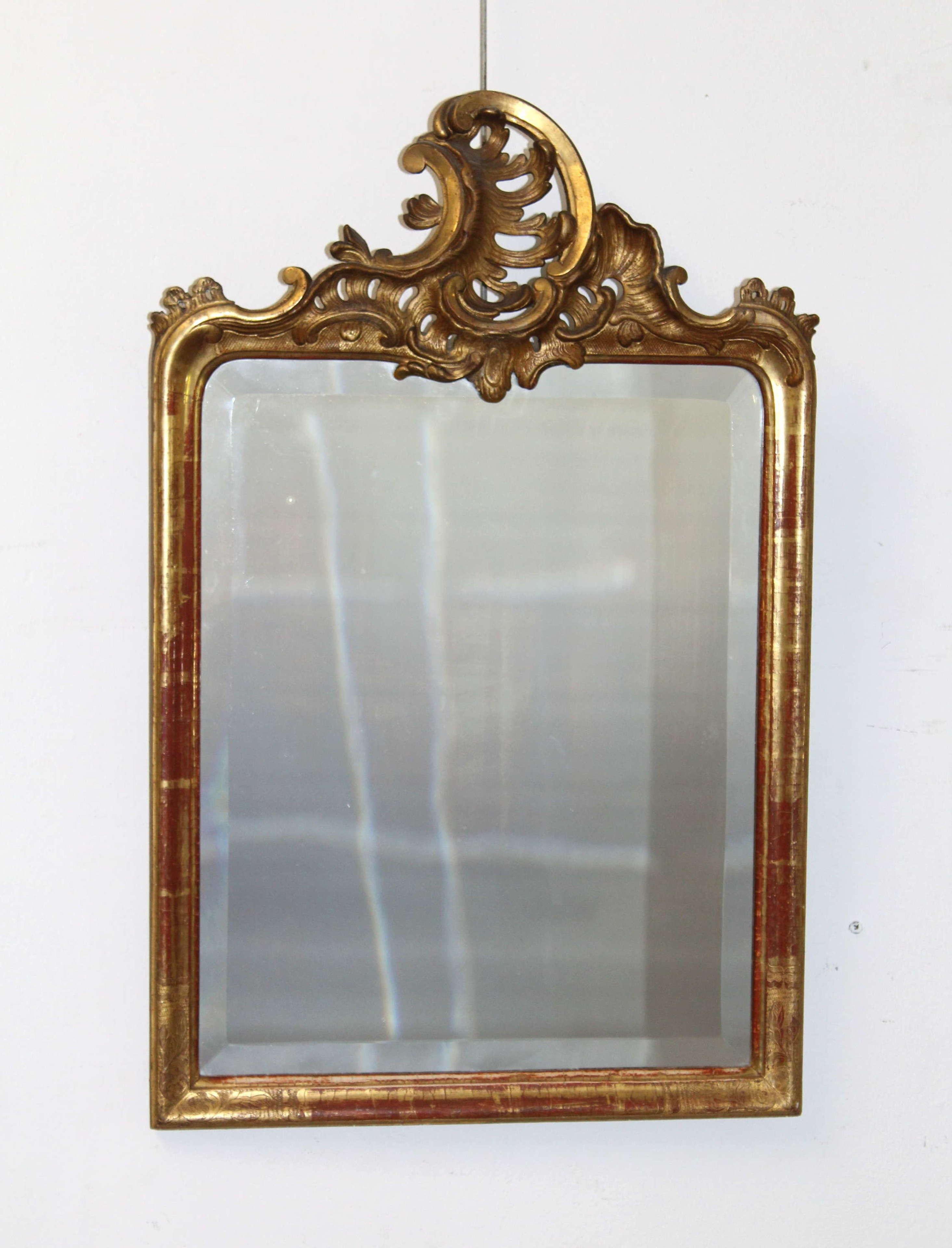 Small, decorative antique mirror with acanthus crest