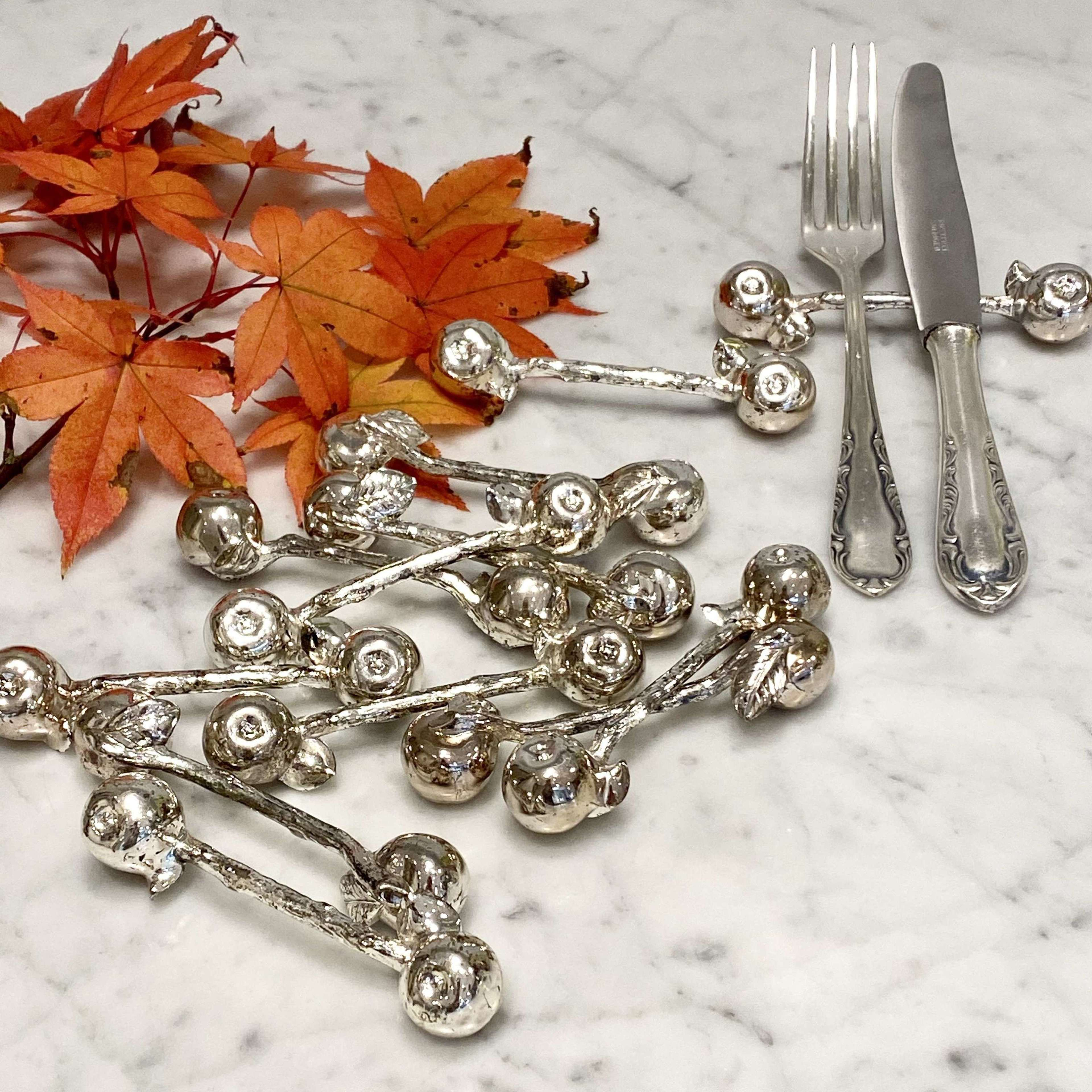 Set of 12 vintage silver plated Apple cutlery rests