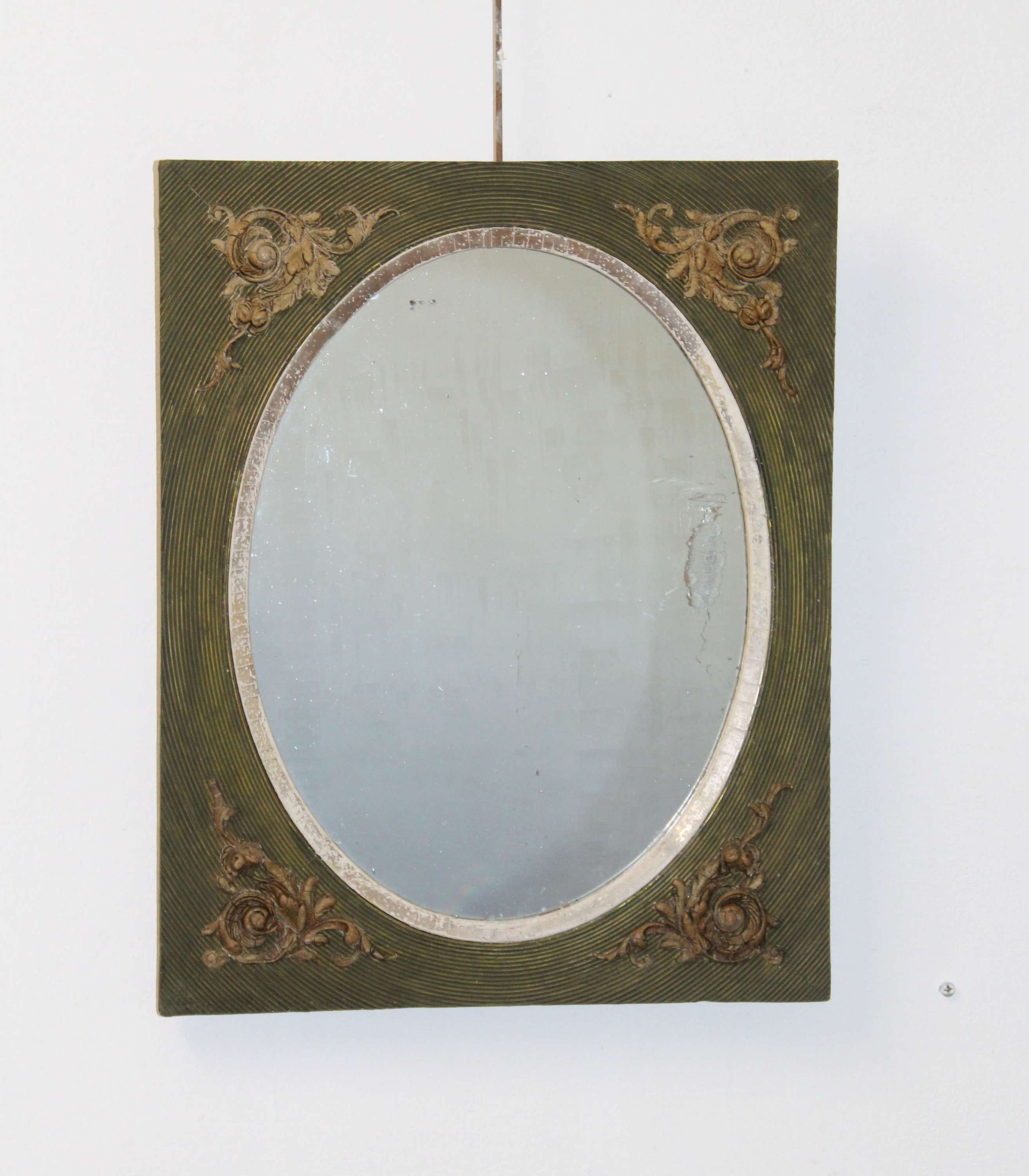 Small antique mirror with green frame and oval glass
