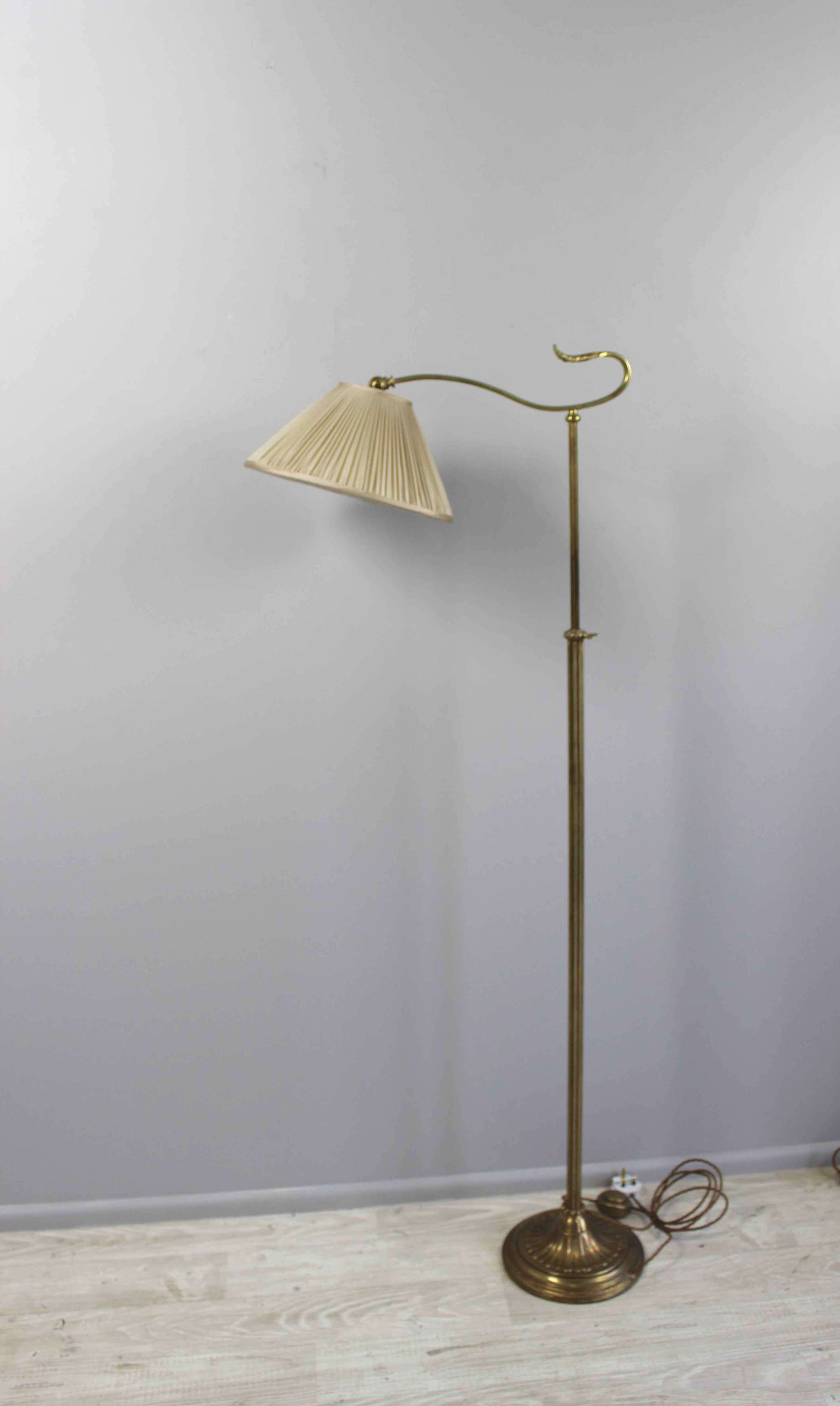Reeded brass adjustble height library light