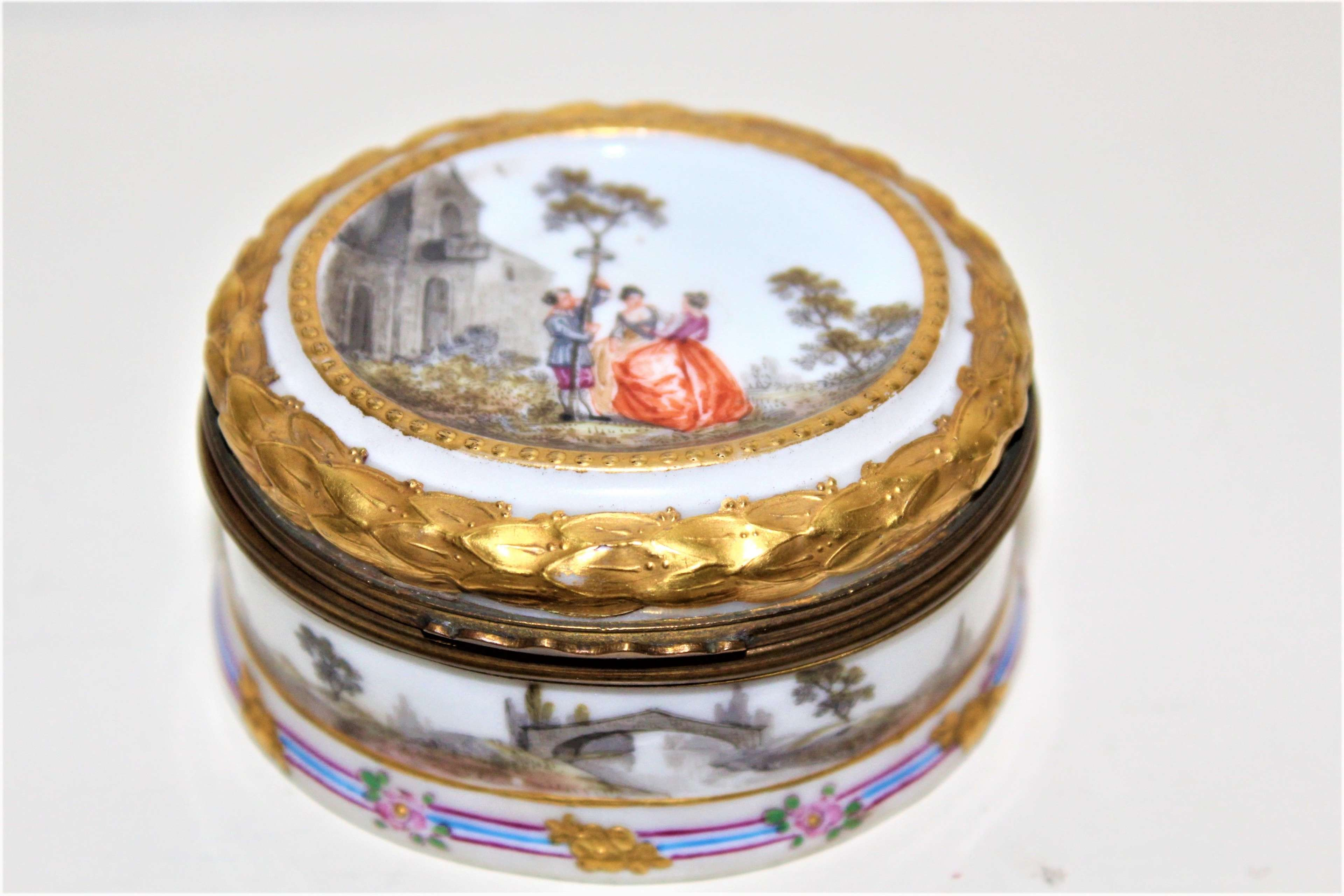 A small  hand painted and heavily gilded Continental porcelain box