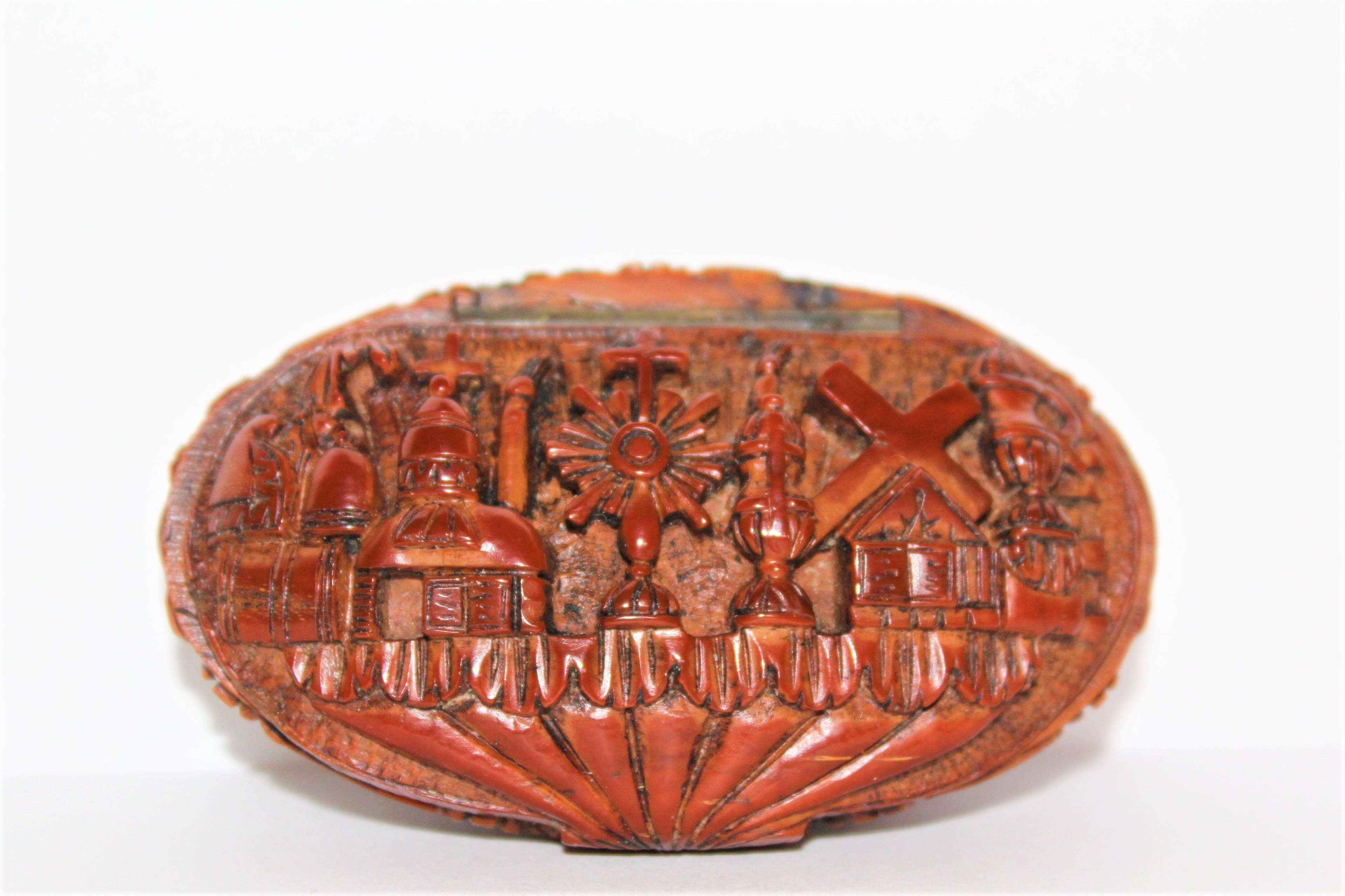 A finely carved Coquilla nut pocket snuff box French Circa 1830