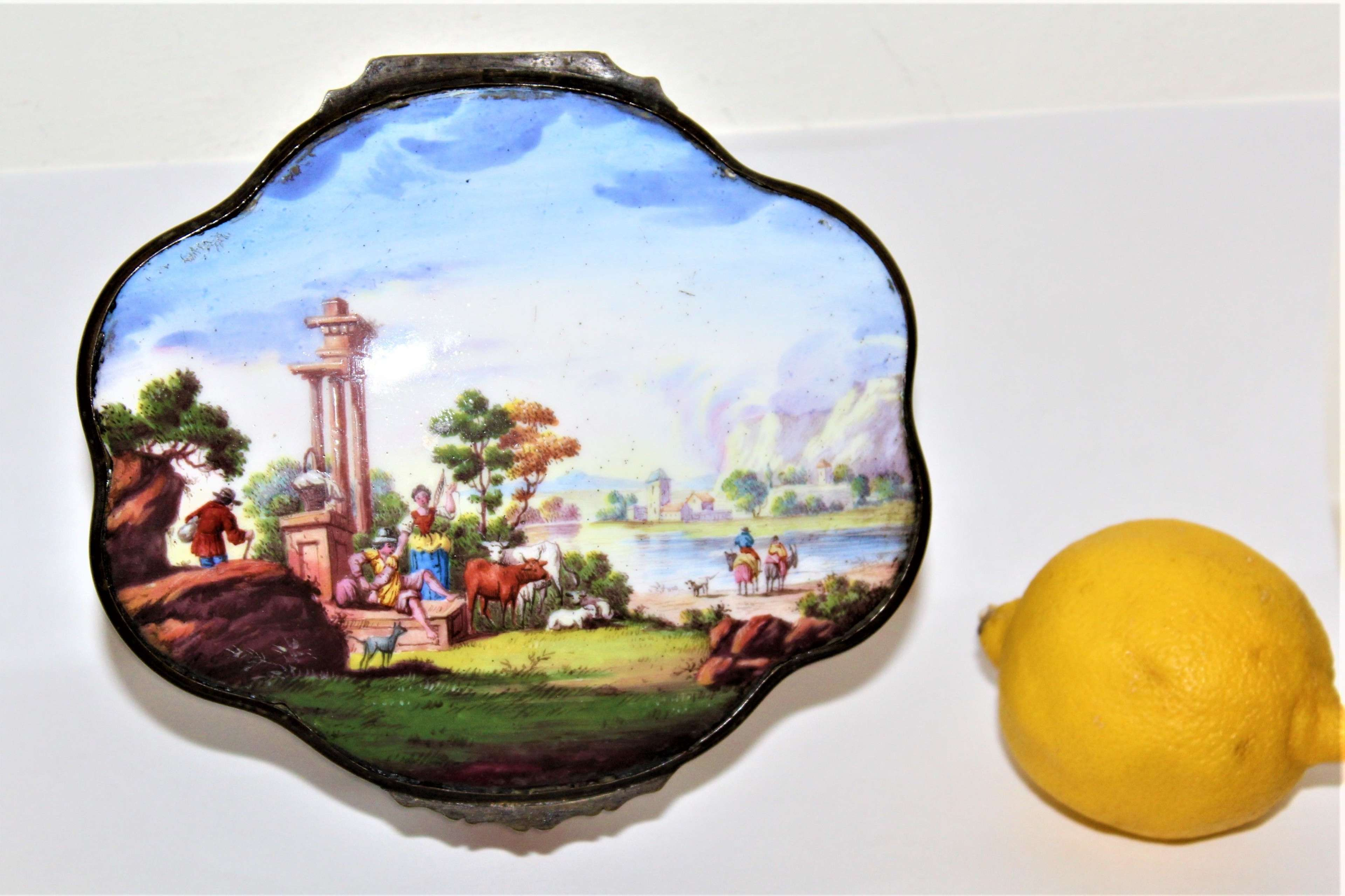 A large 18th/19th Century oval shaped Bilston enamel box well painted