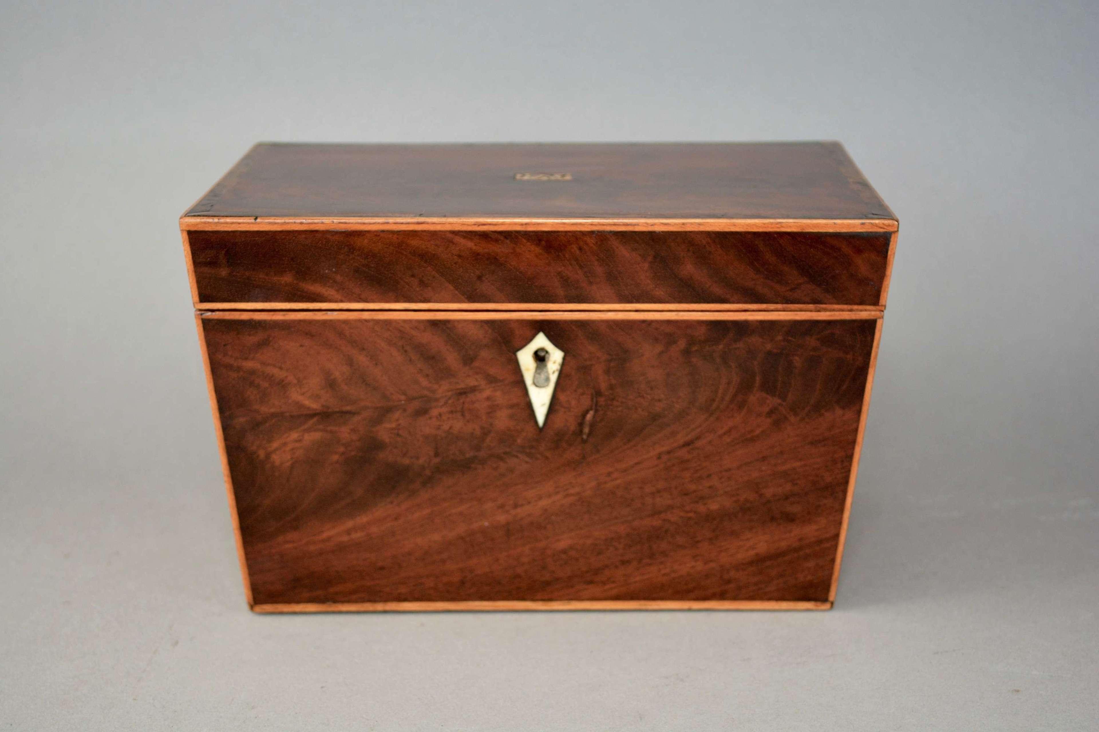 George III flamed mahogany canted side tea caddy circa.1810