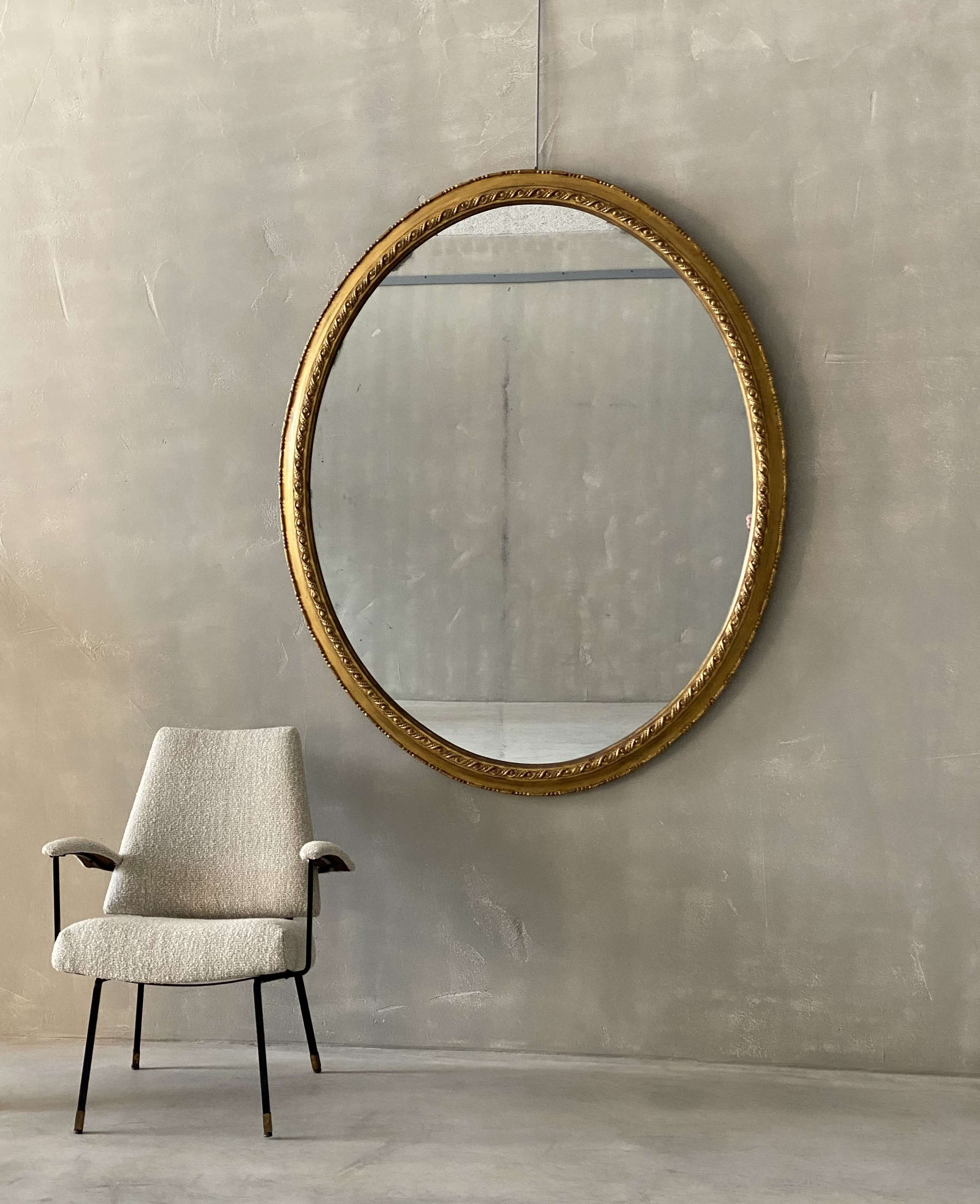 A Large C19th English oval mirror