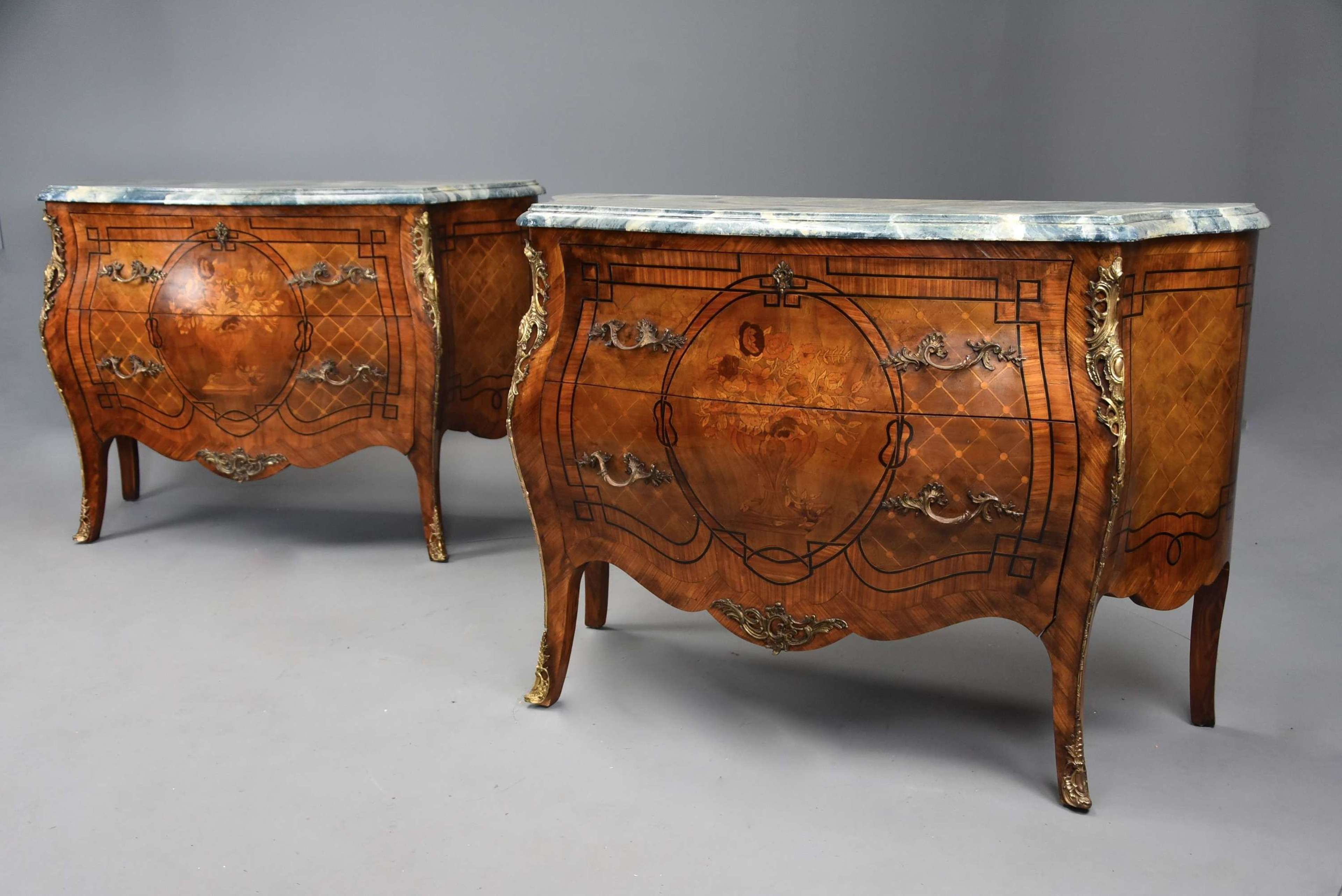 Pair of French early 20thc highly decorative Kingwood bombe commodes