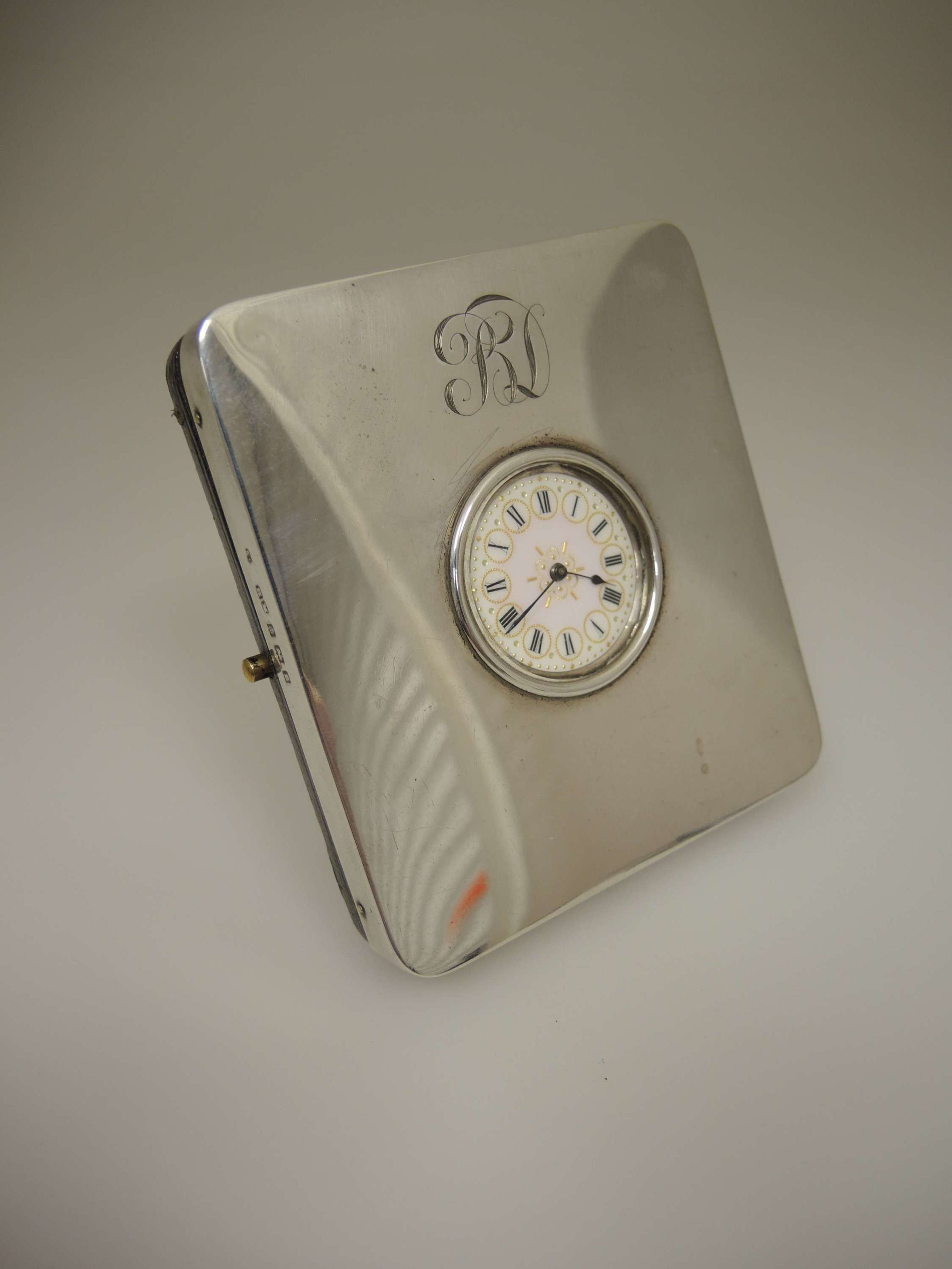 English silver watch stand with a fancy dial fob watch c1905