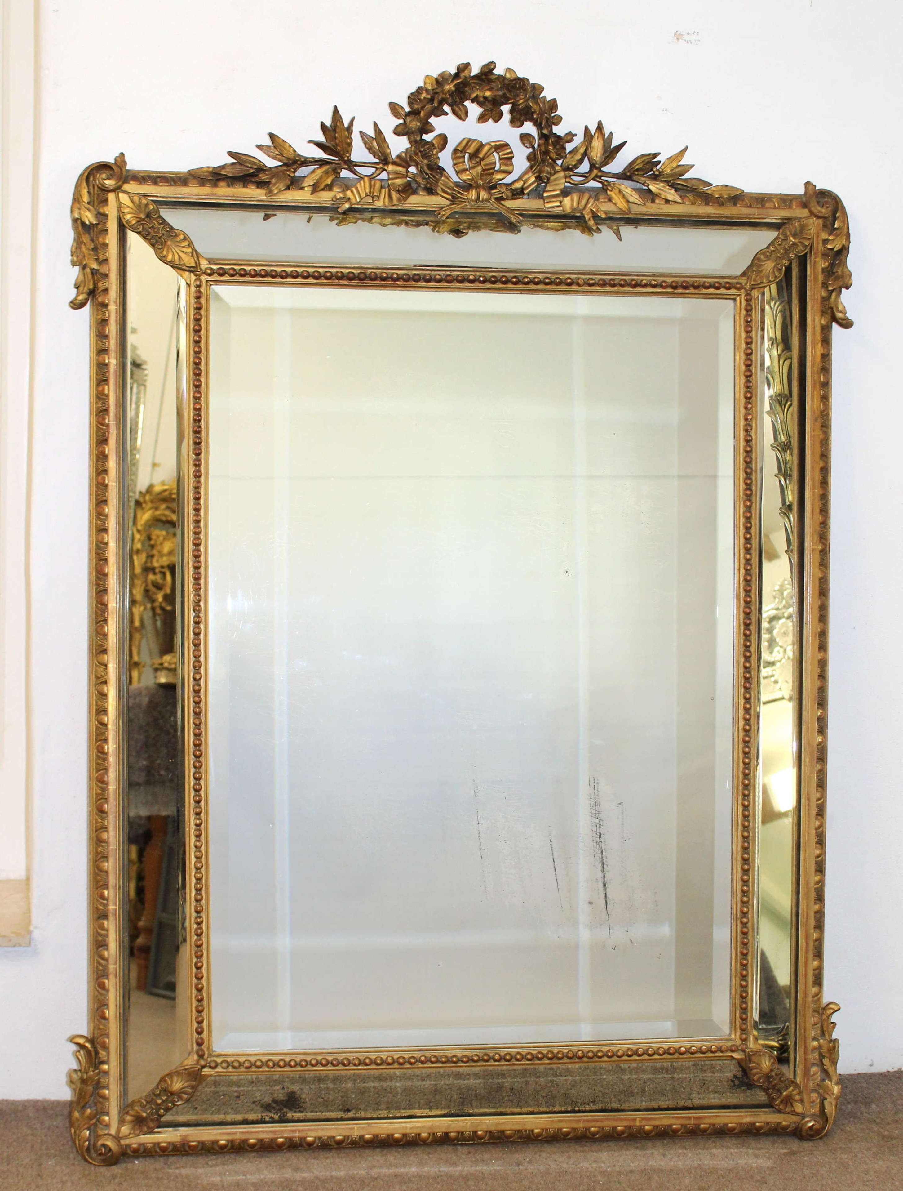 Antique French gilt cushioned mirror with circlet cartouche