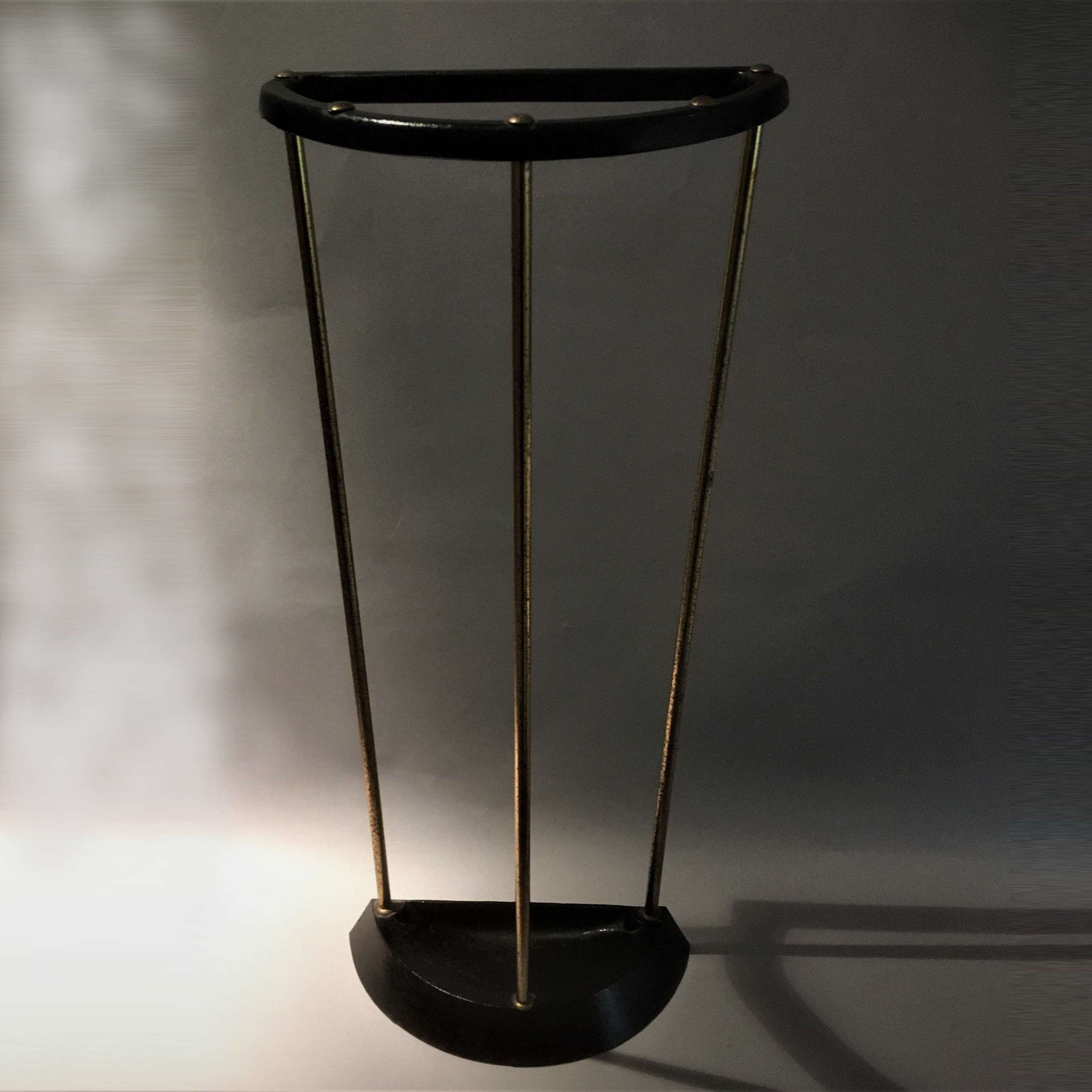 A good mid-century modern demi-lune walking stick or umbrella stand