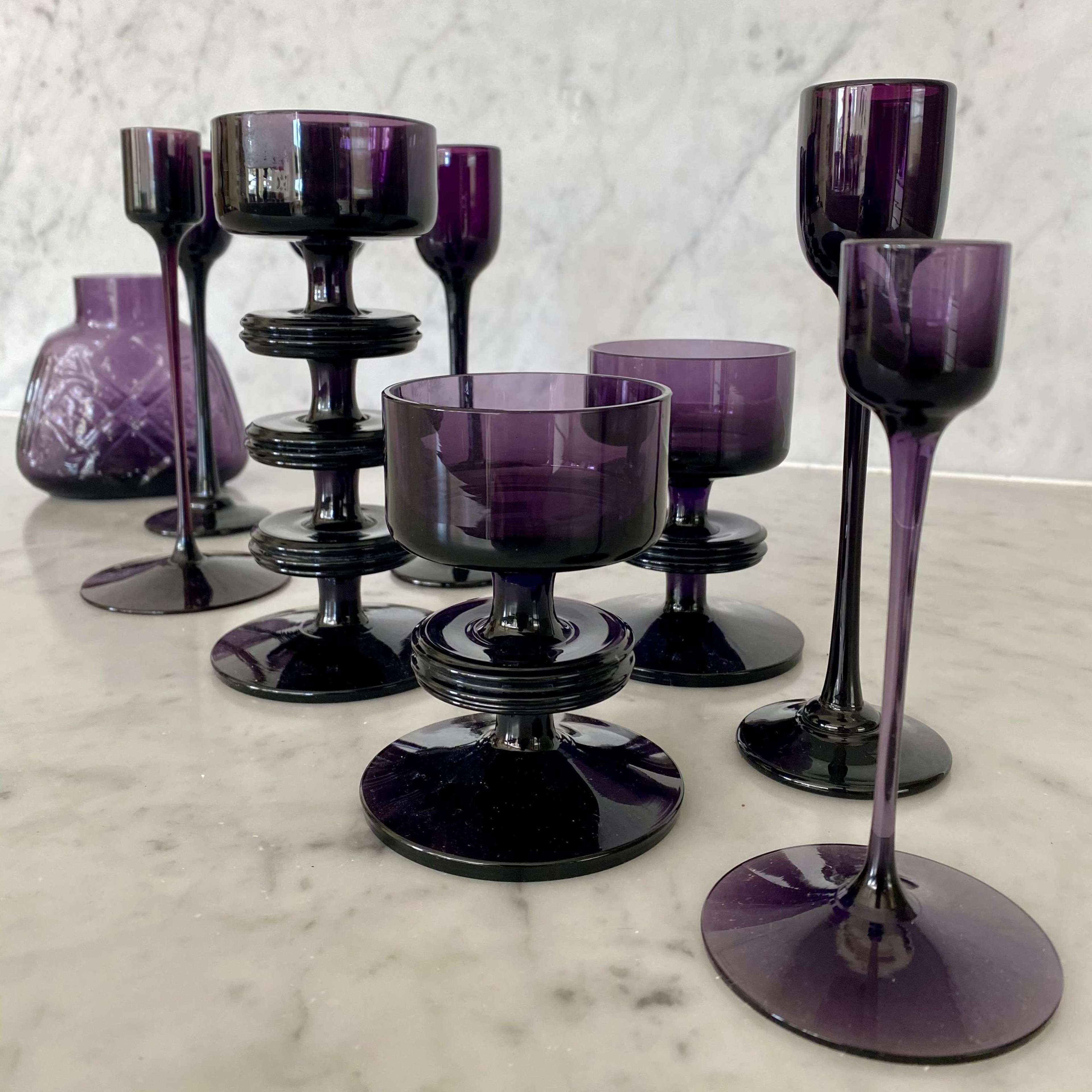 Matched set of 1970s purple glass candlesticks and vase