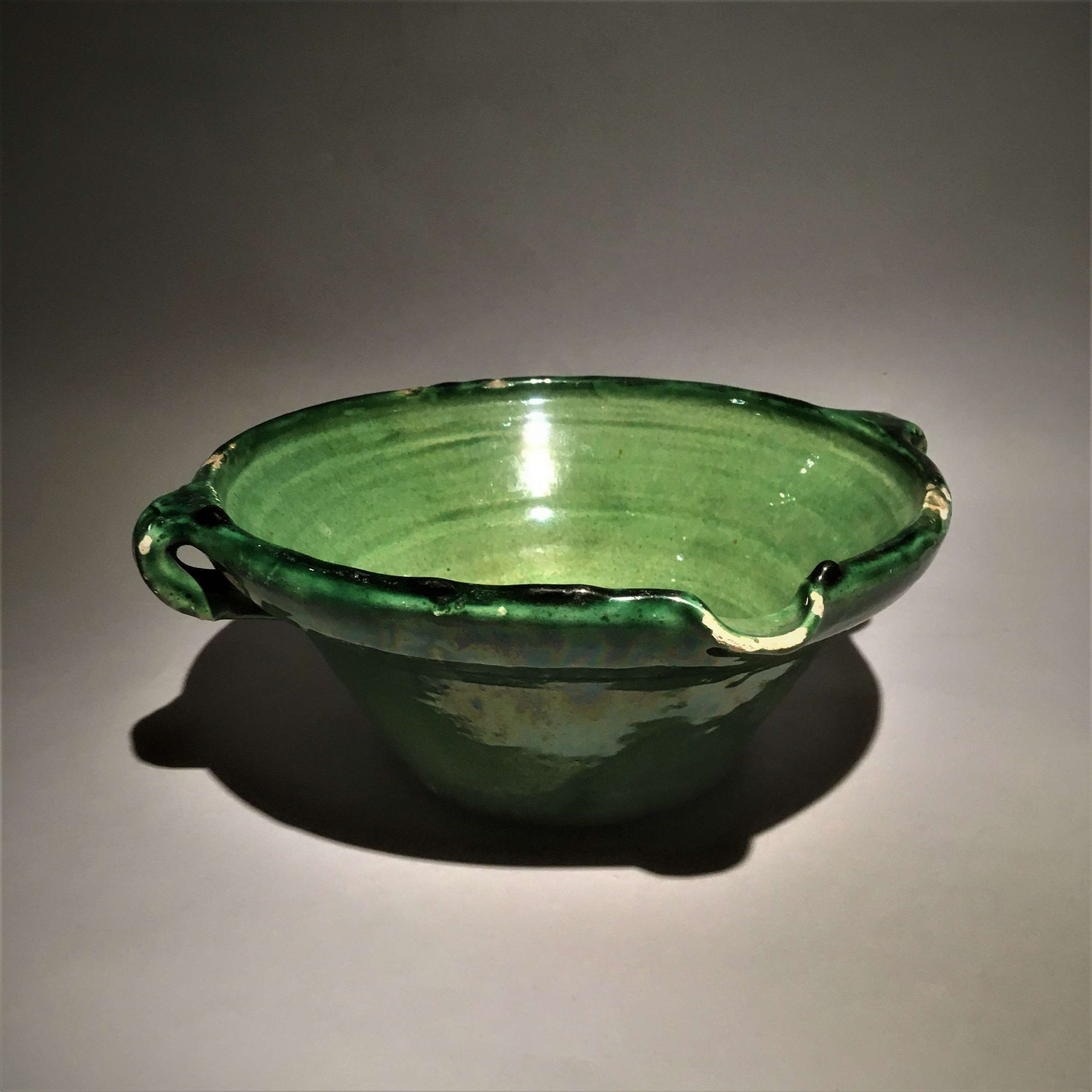 A French green glazed earthenware dairy bowl or 'tian'