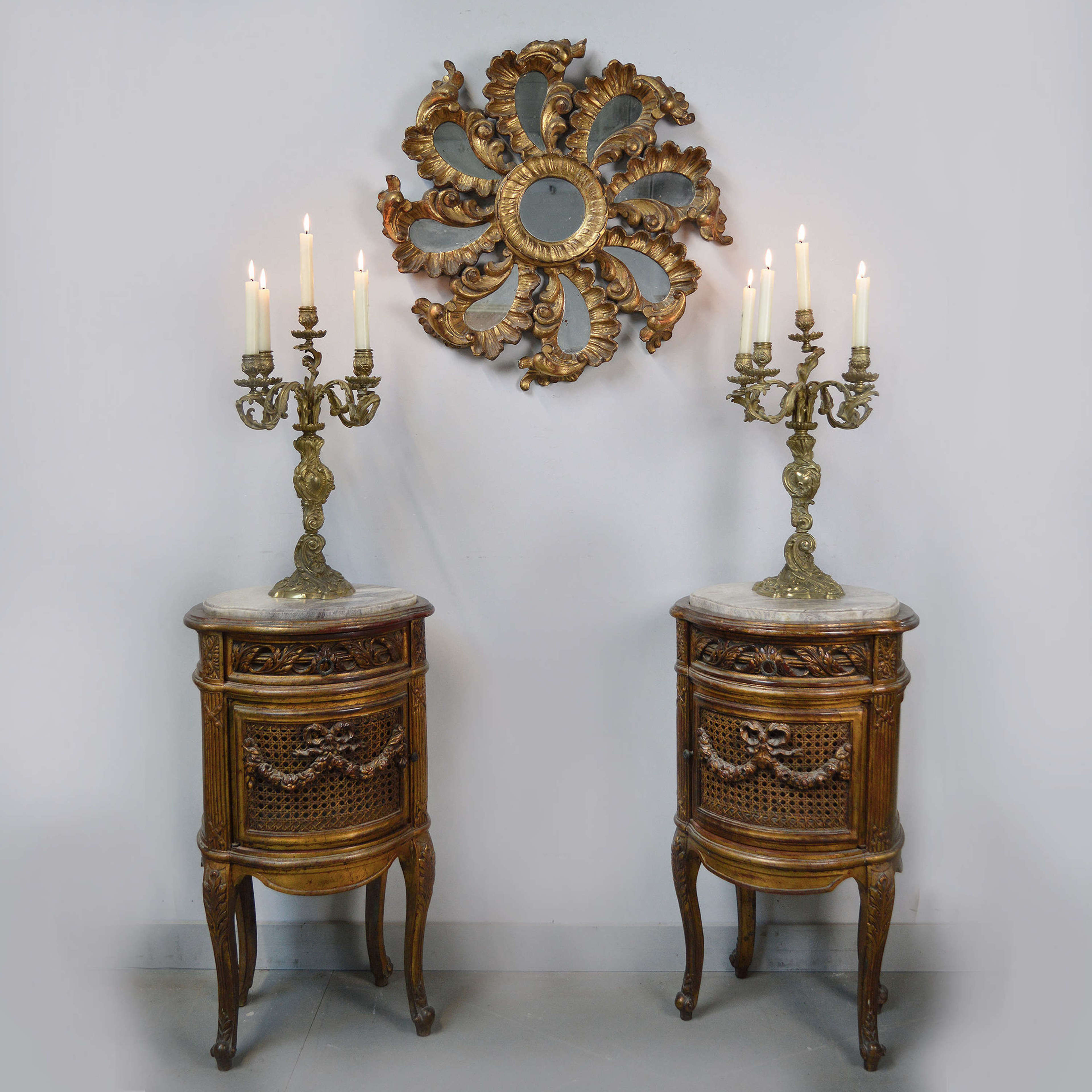 Pair of Louis XVI style giltwood bedside cabinets