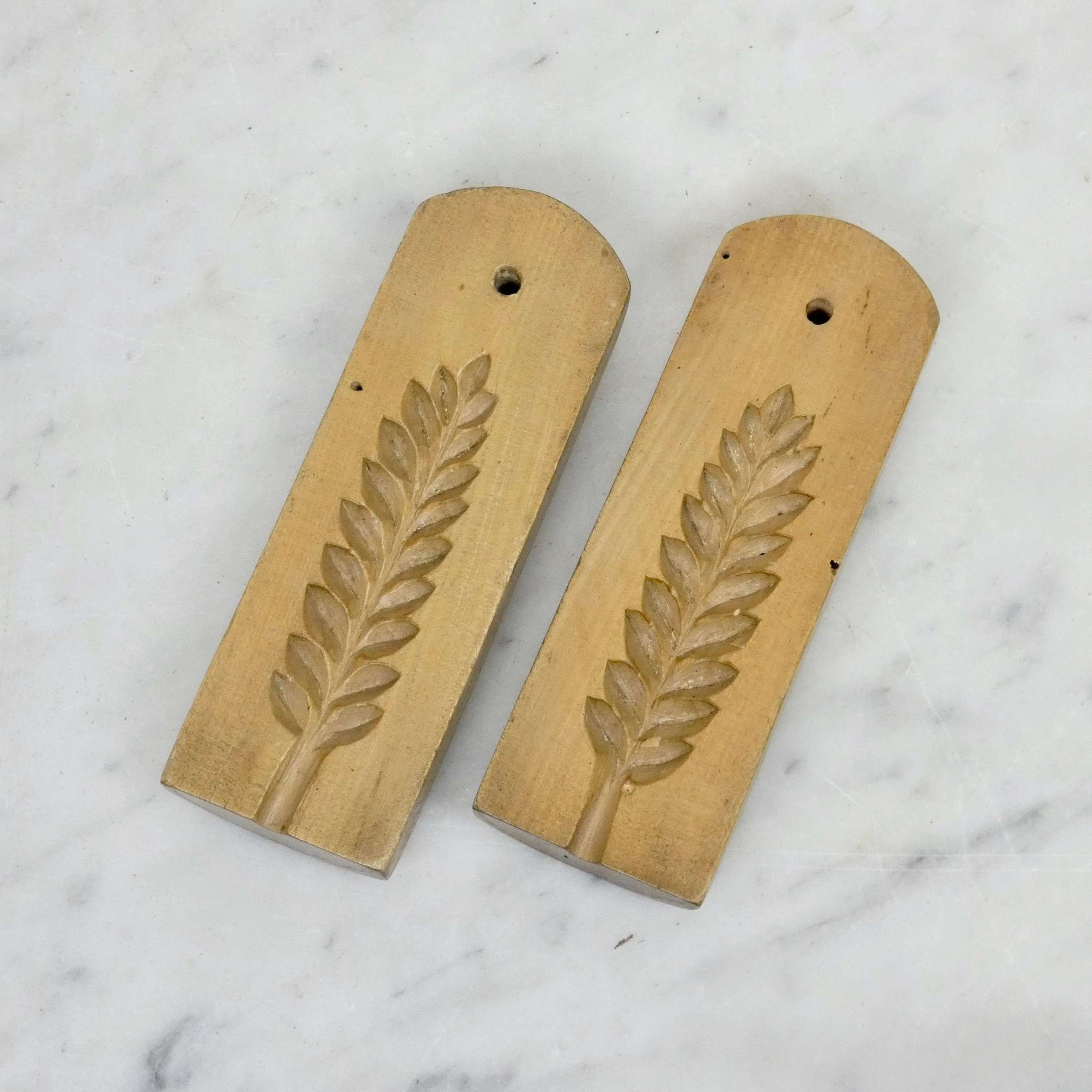 Wooden butter mould carved with a leaf