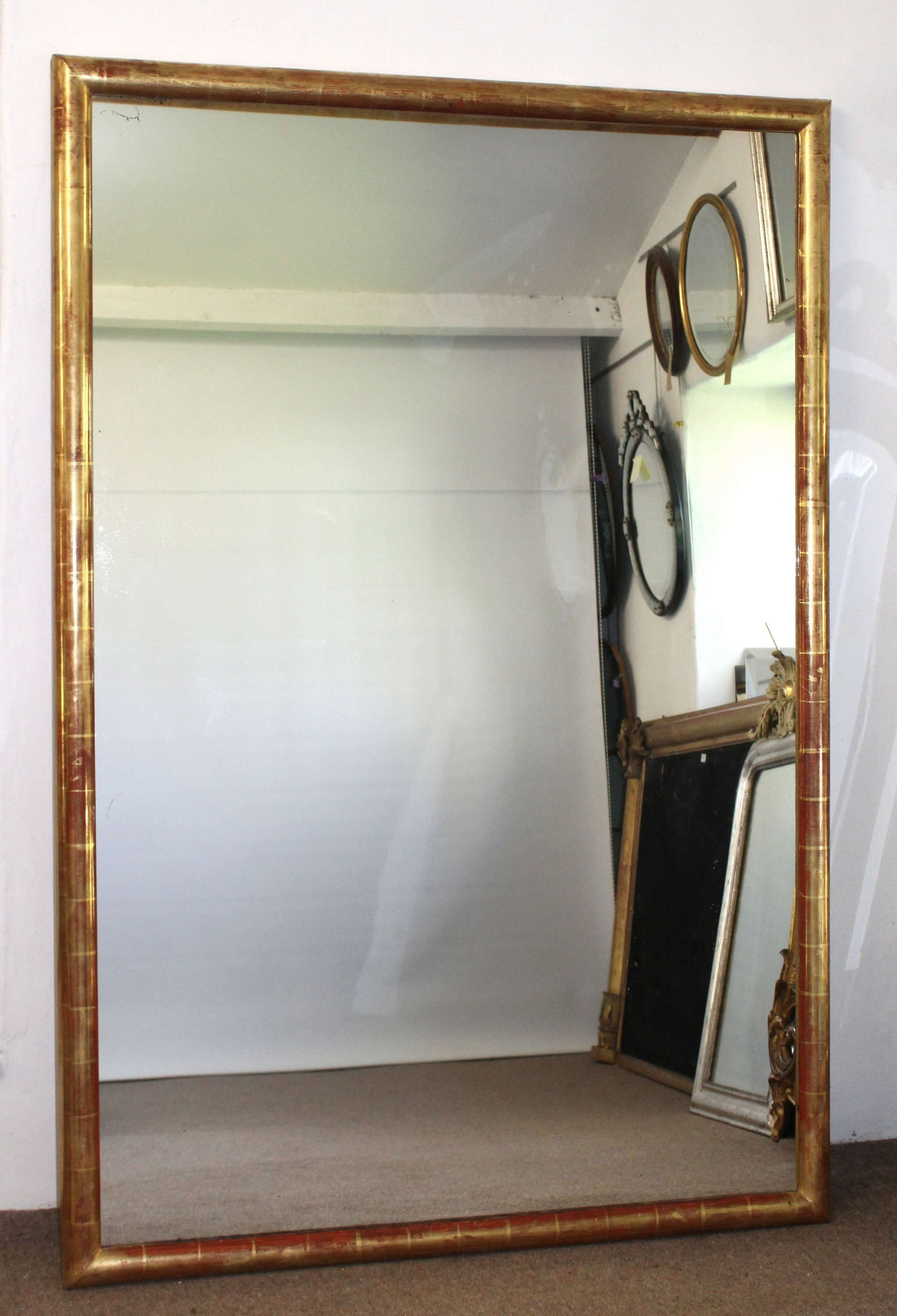 Large antique watergilt framed mirror