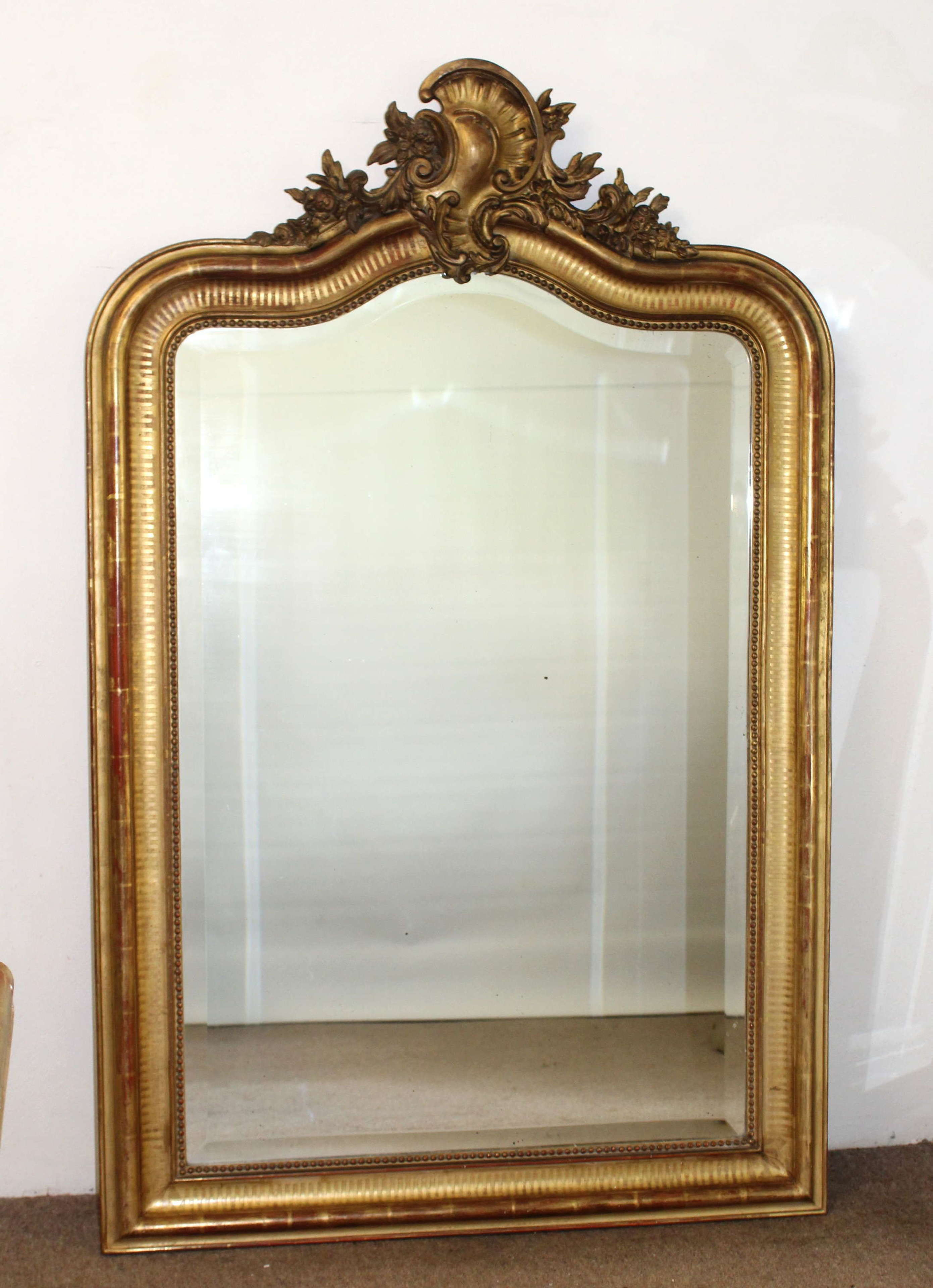 Antique French mirror with serpentine top and cartouche