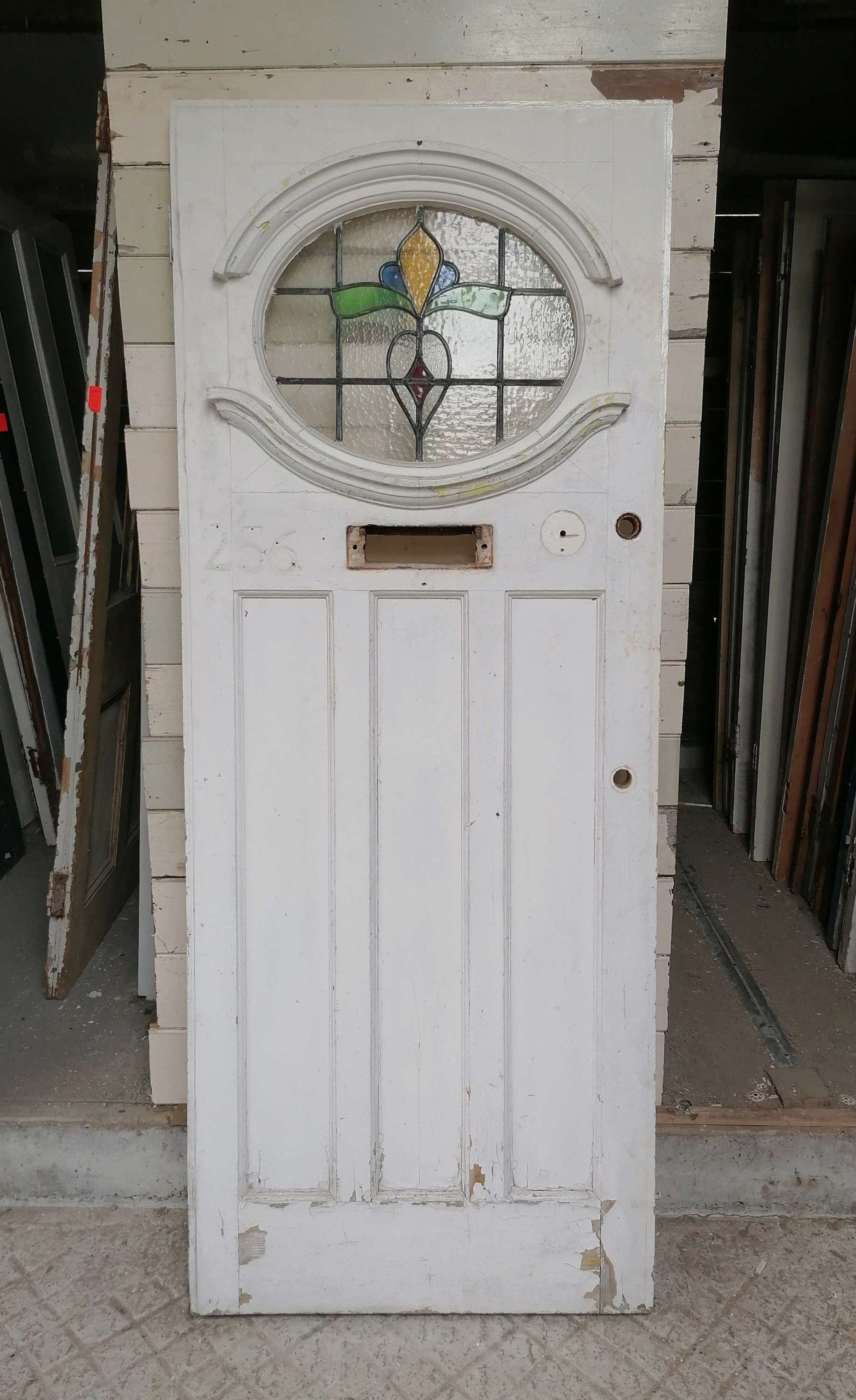 DE0892 A RECLAIMED EDWARIDAN PINE FRONT DOOR WITH STAINED GLASS