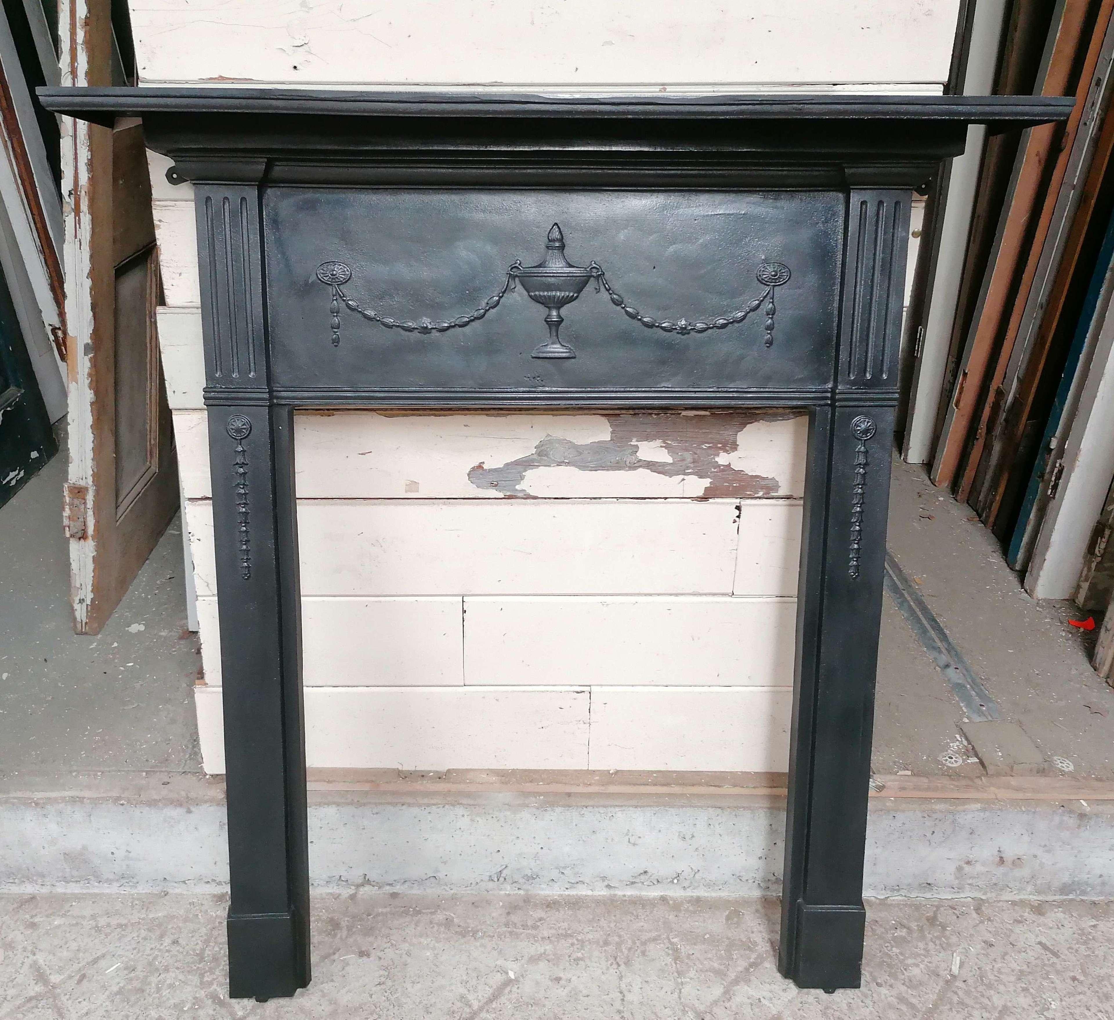 FS0151 AN EDWARDIAN CAST IRON FIRE SURROUND FOR WOOD BURNER / BASKET