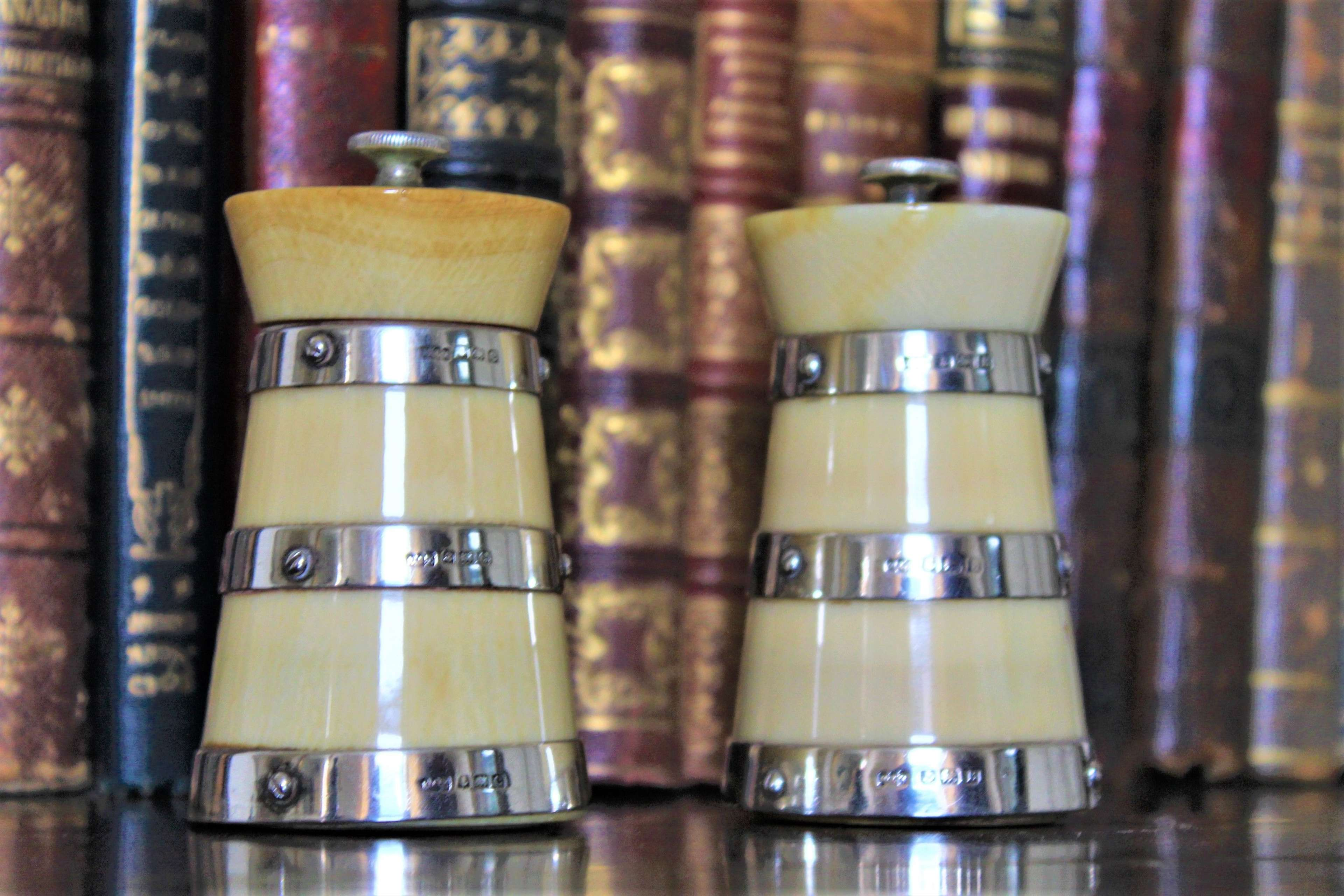 A superb pair of salt and pepper grinders in ivory and silver