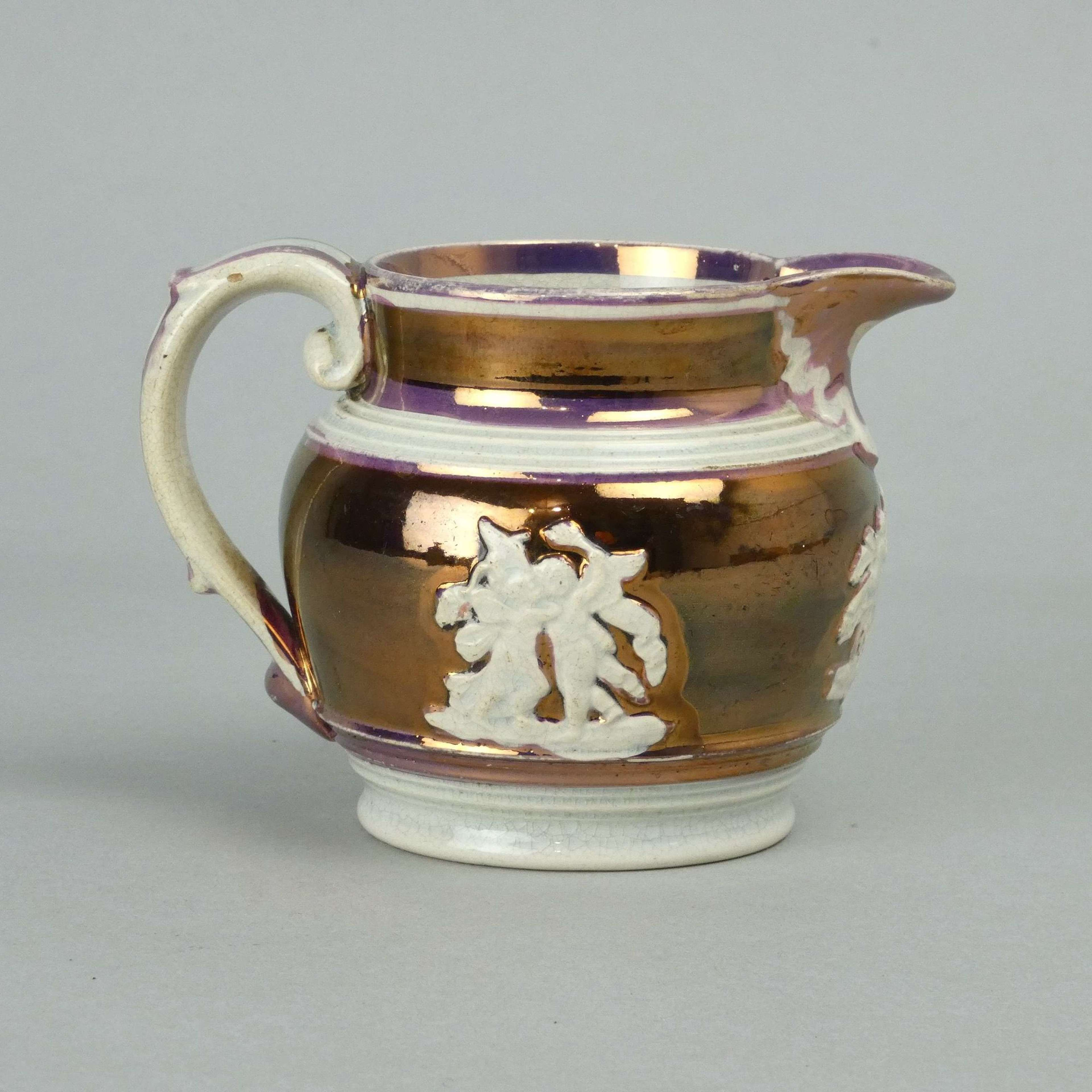 Small, copper and pink lustre jug