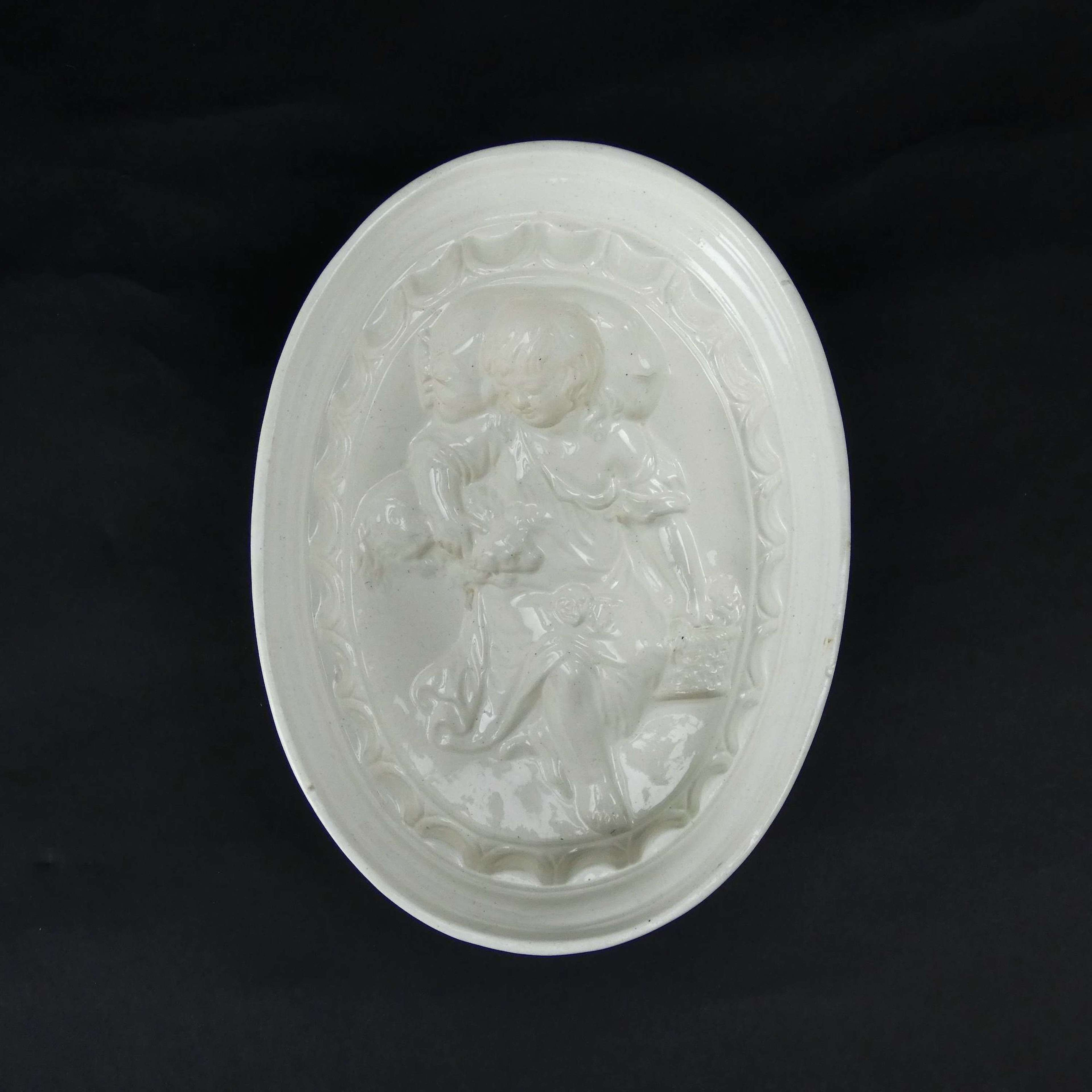 Creamware mould with child and dog