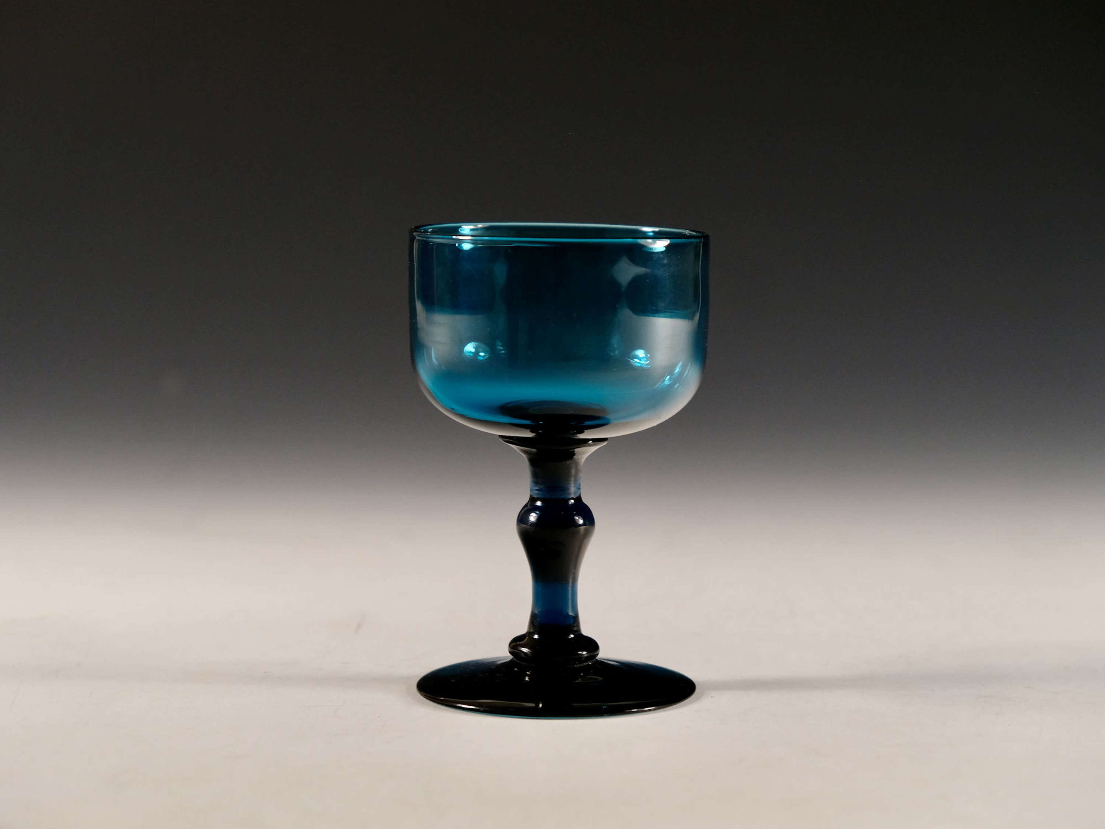 Antique glass teal wine glass English c1820