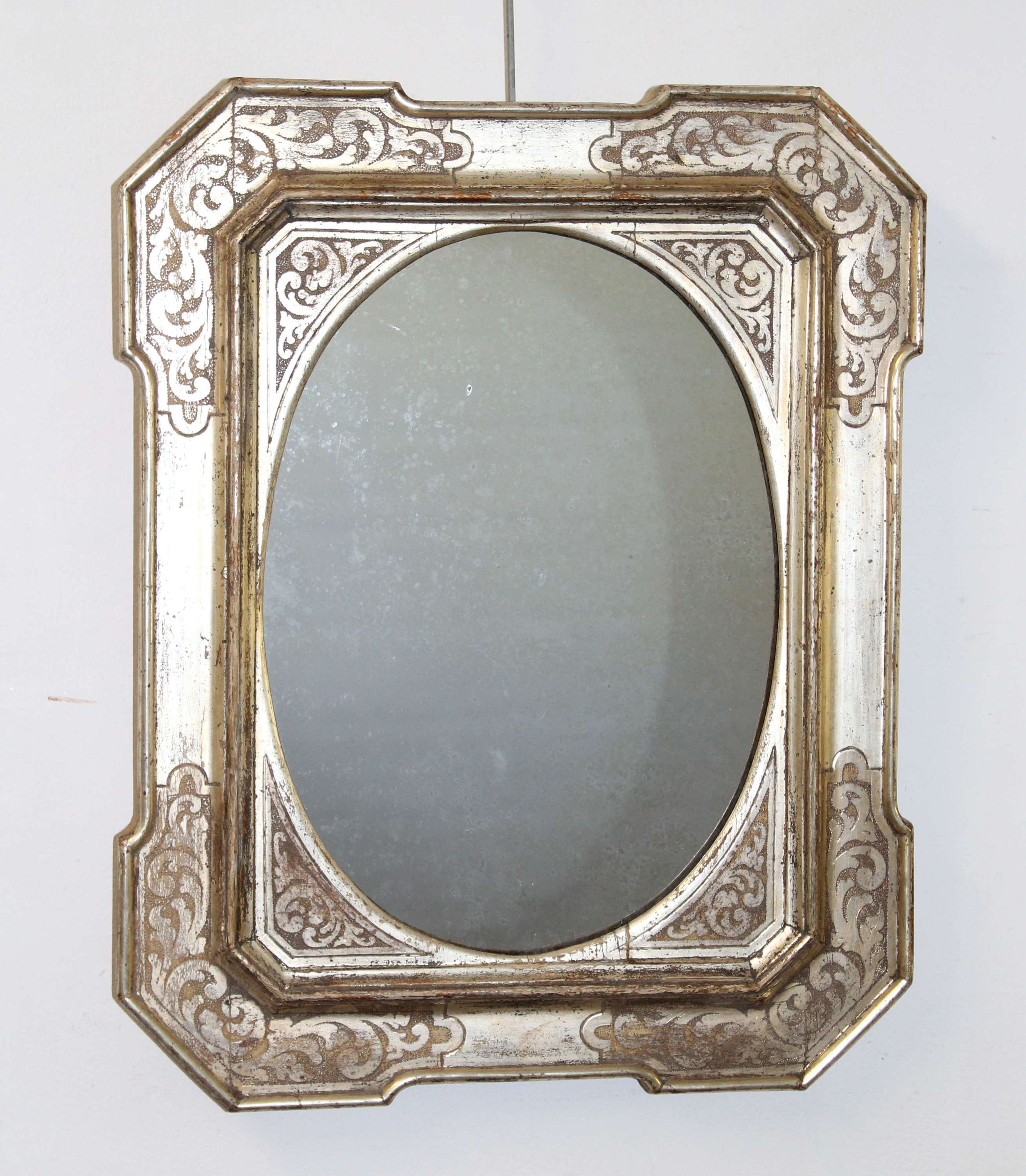 Small antique Italian mirror with silverleafed frame