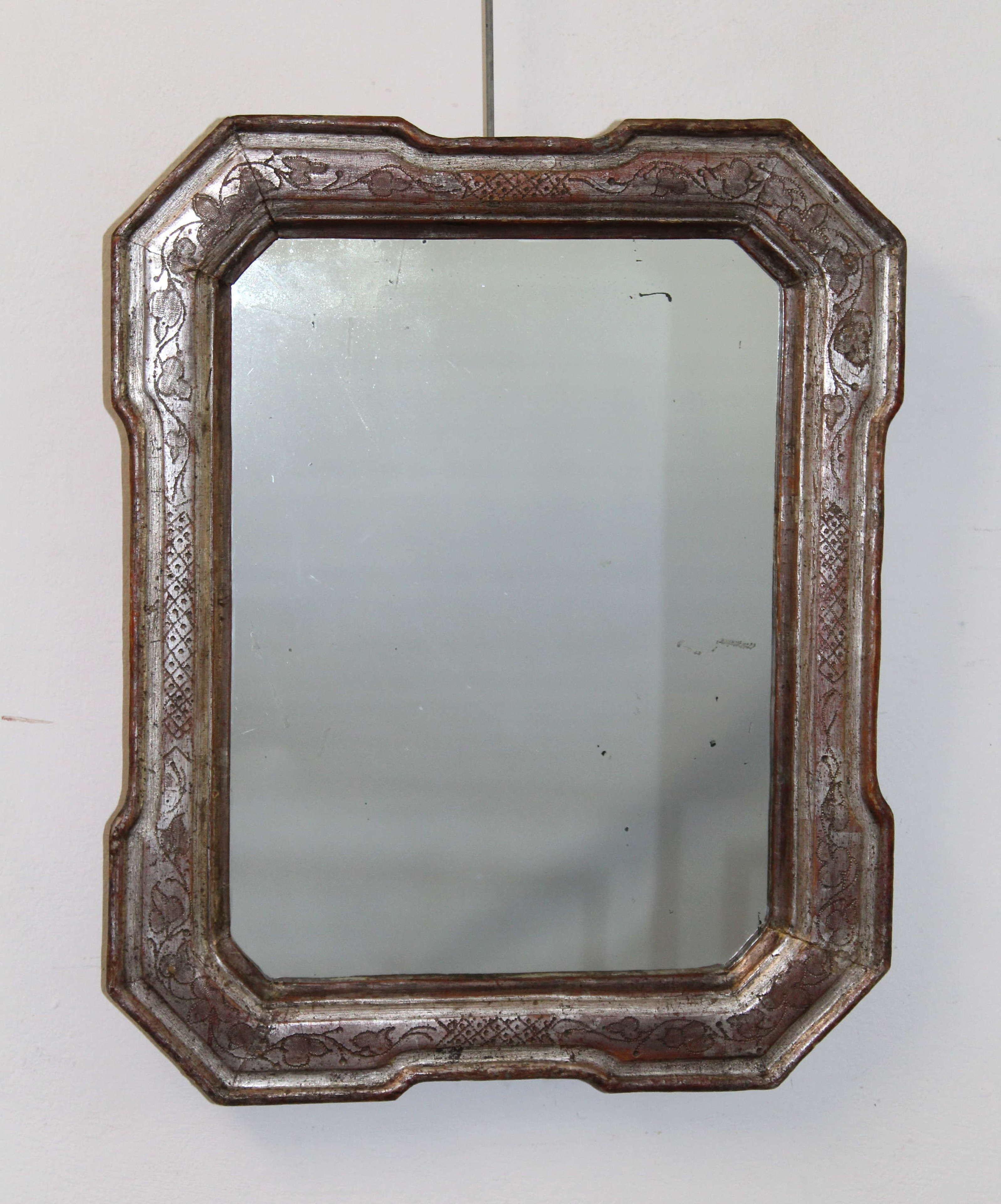 Small antique silverleafed Italian mirror
