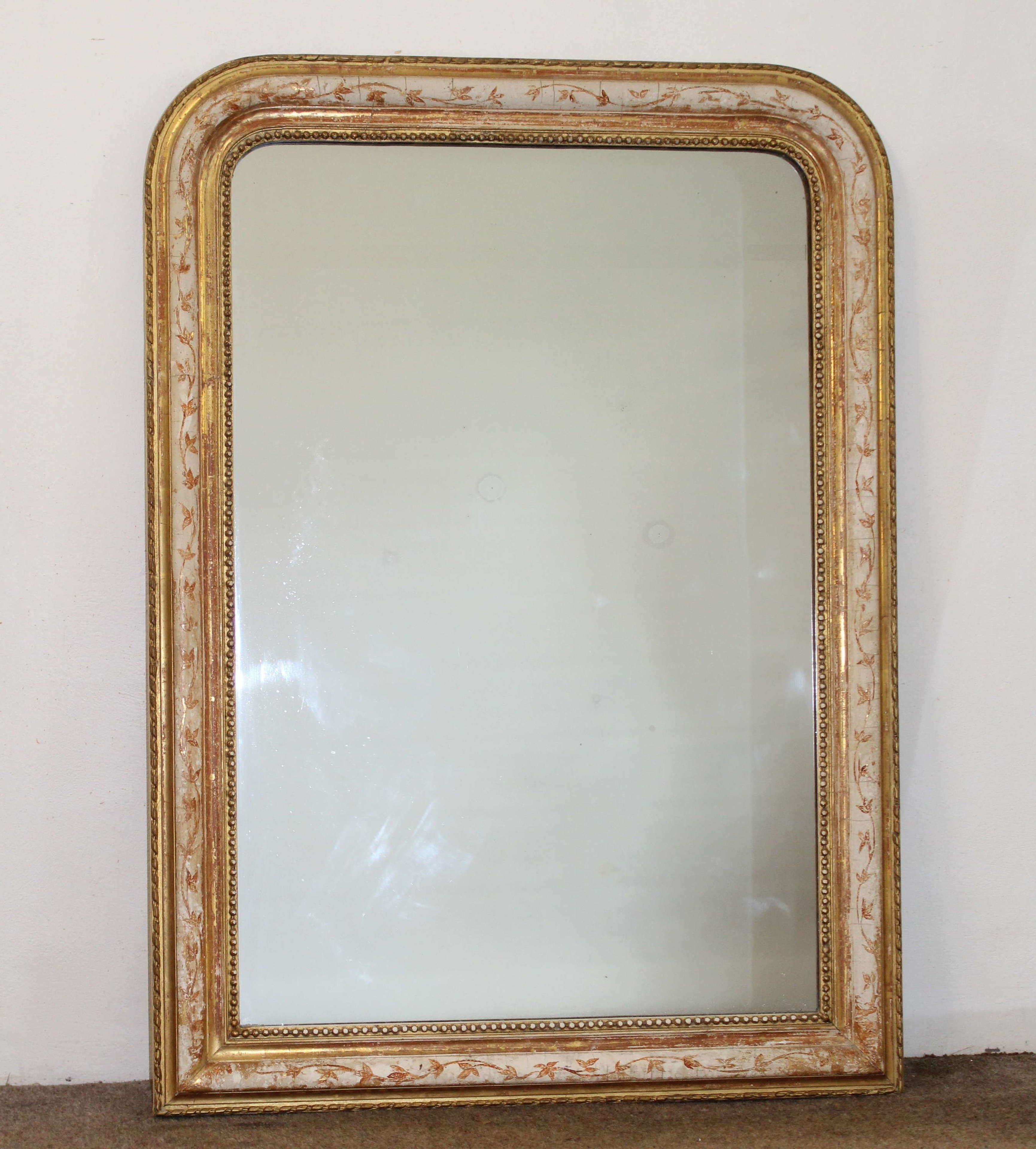 Antique French archtop with cream, gold and terracotta frame