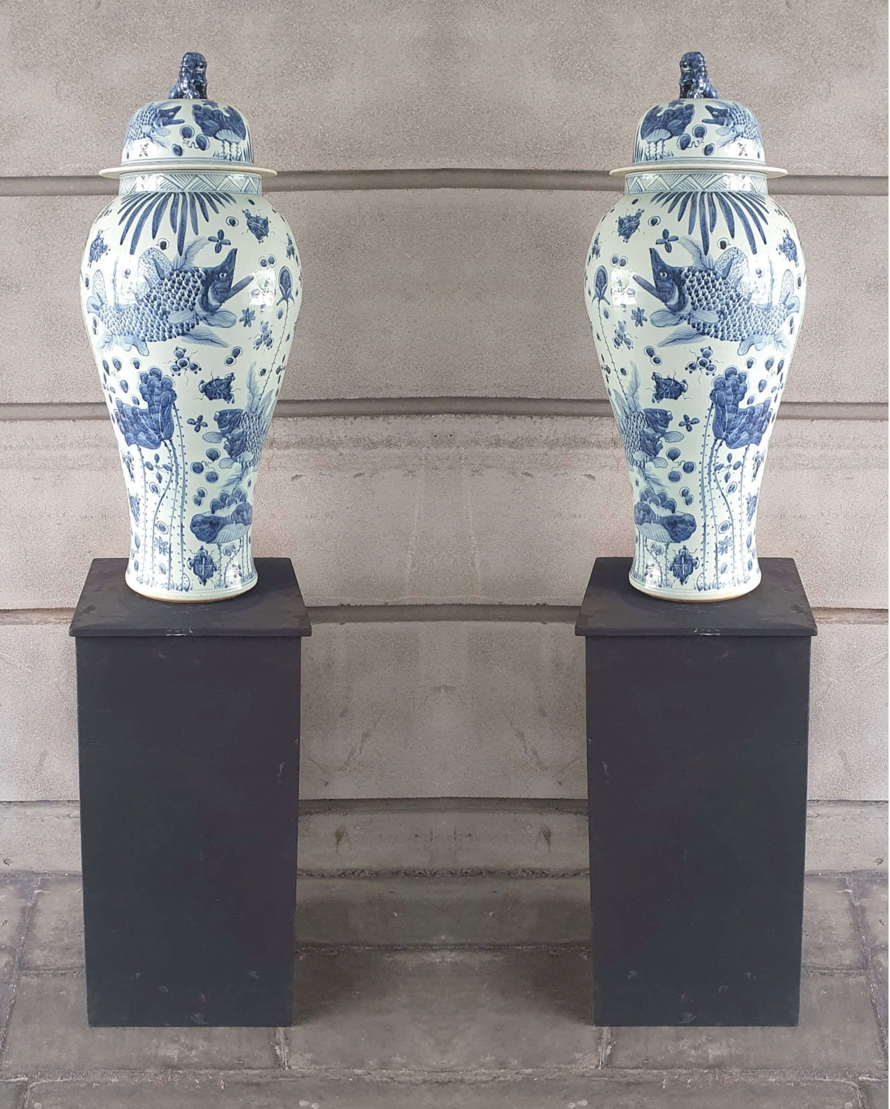 Pair of 20th Century Urns on Stands