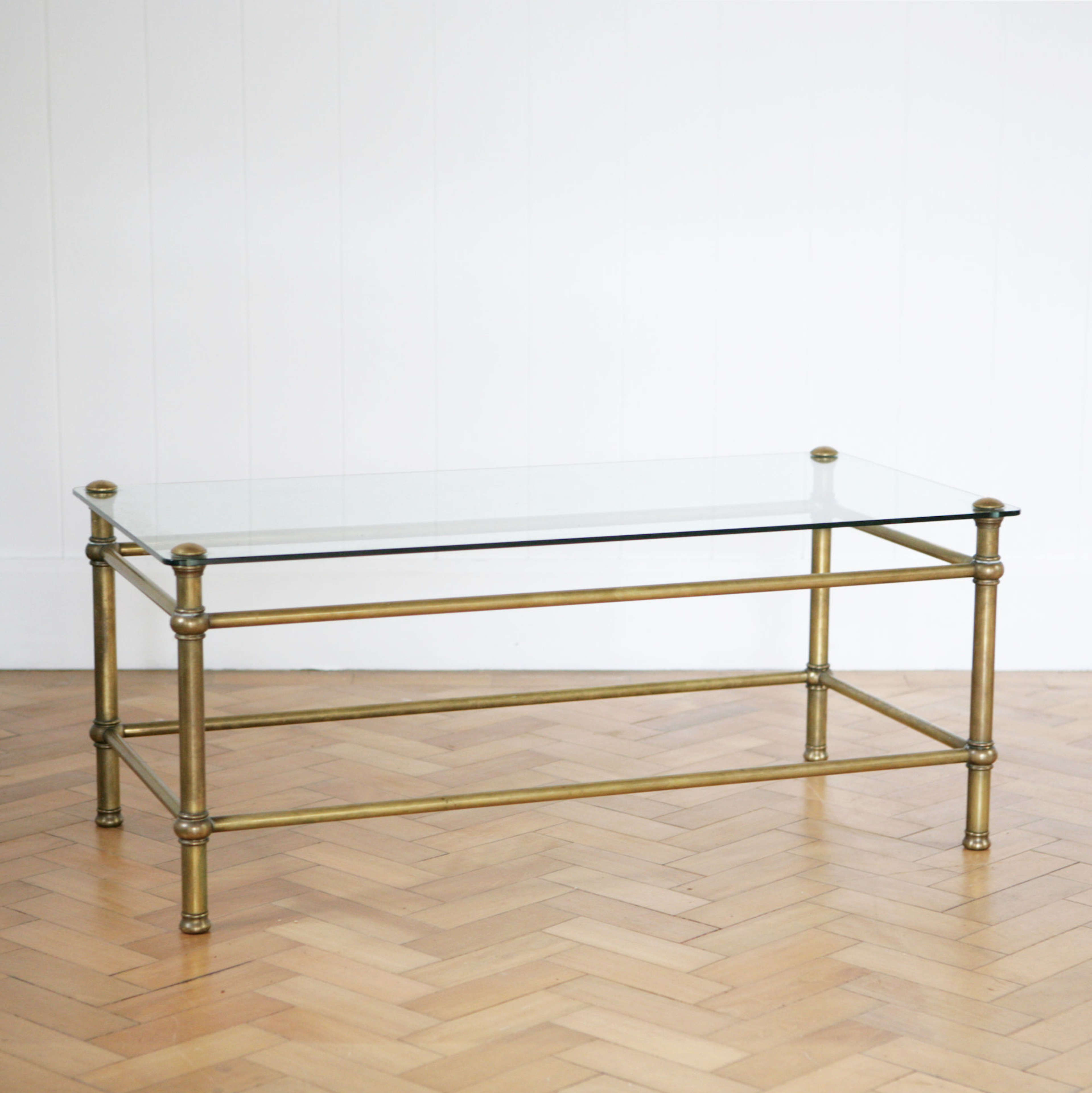 A brass and glass classic design coffee table.