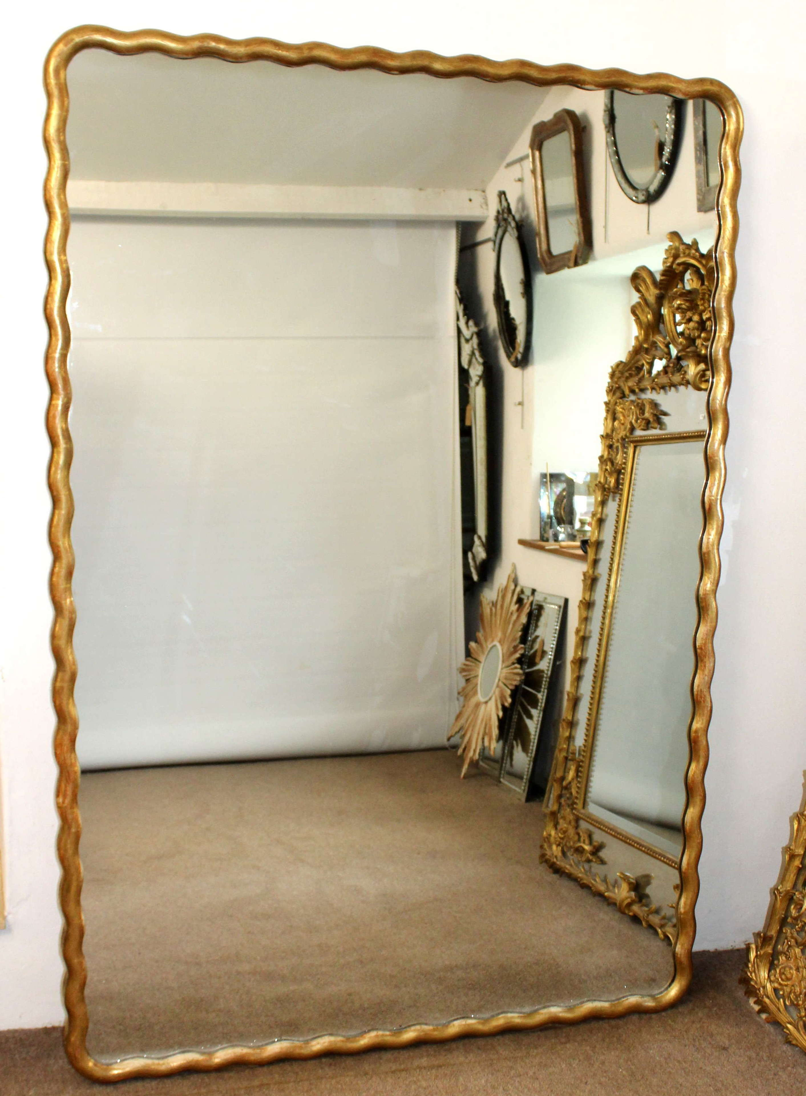 Huge antique French gilt mirror with undulating frame