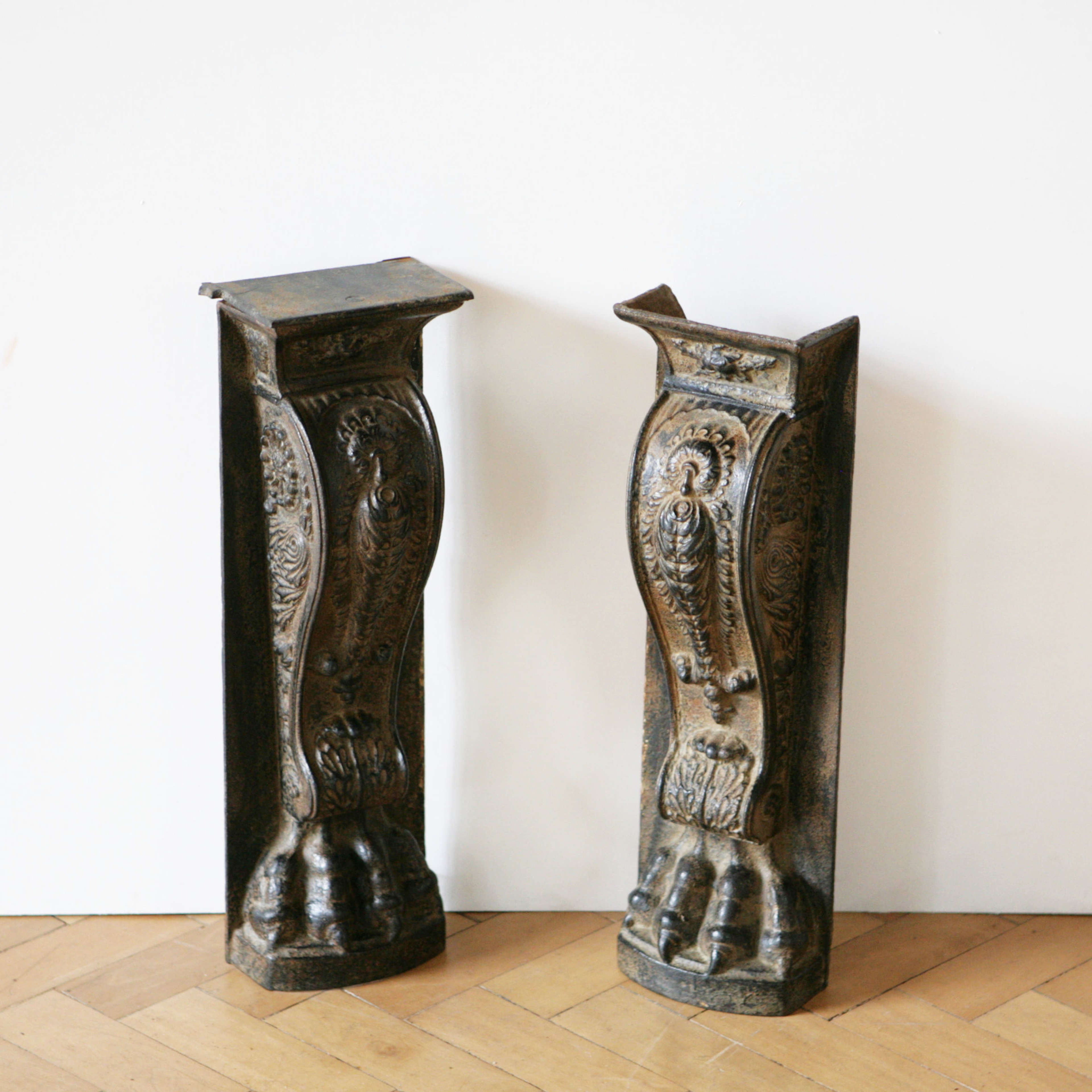 Pair of architectural cast iron lion paw columns