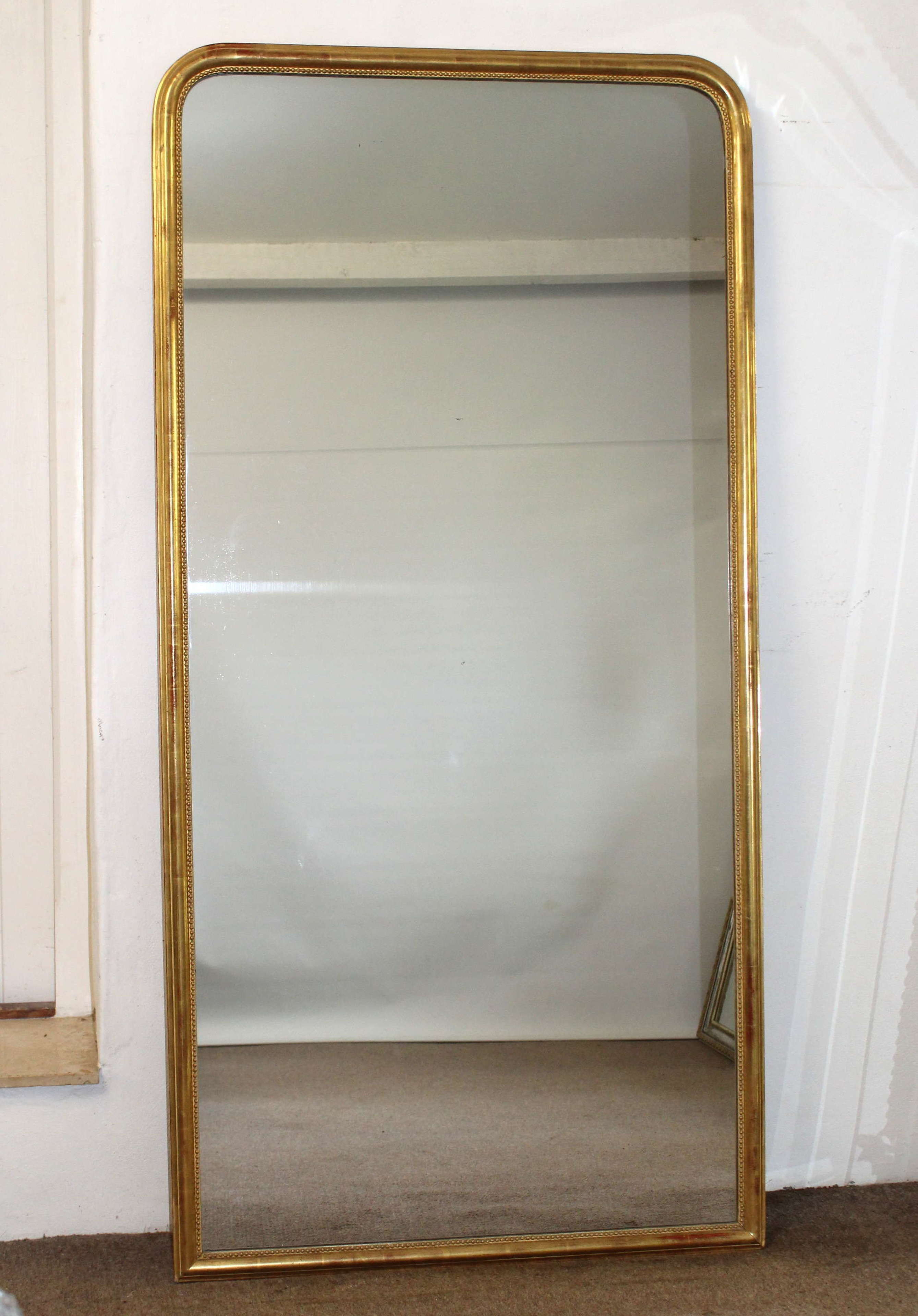 Simply elegant antique French archtop mirror