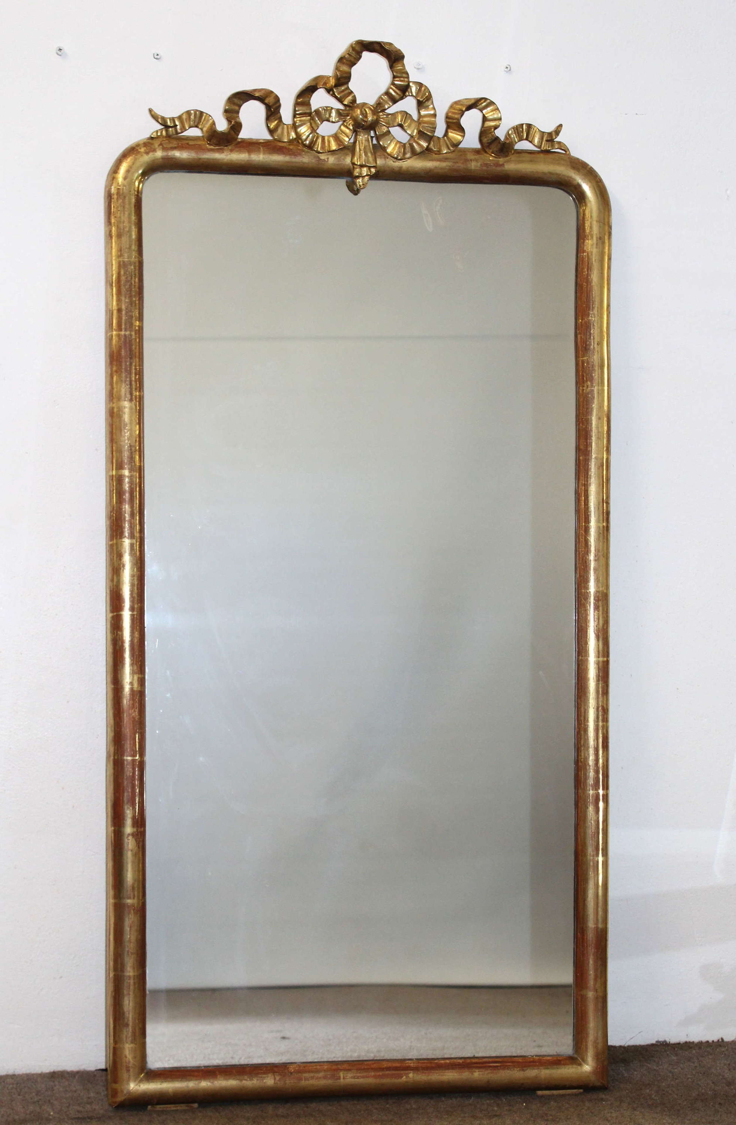 Antique French archtop mirror with bow