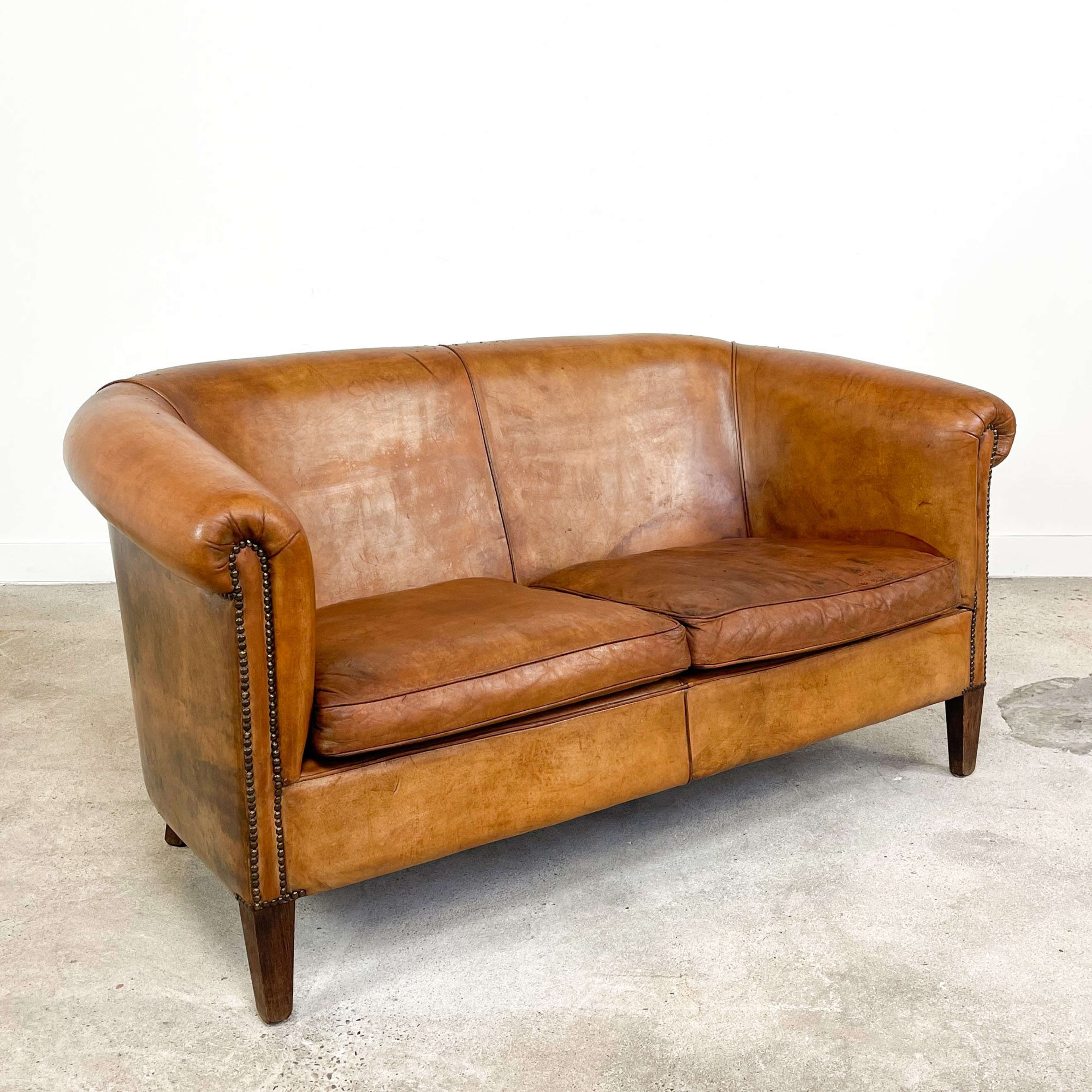 Vintage hand colored sheep leather two seater club sofa