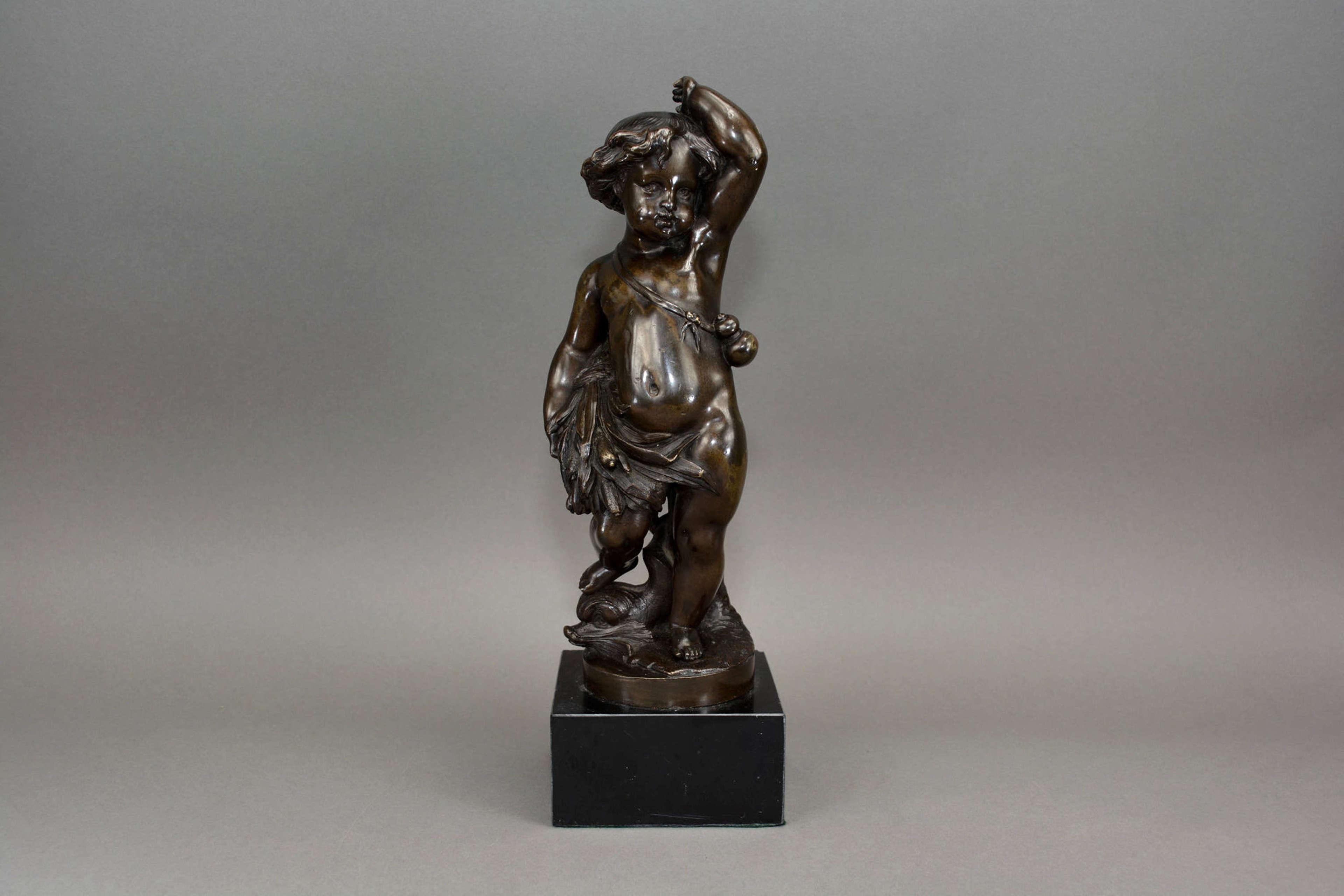 Antique bronze figure of a cherub holding a wheat sheaf