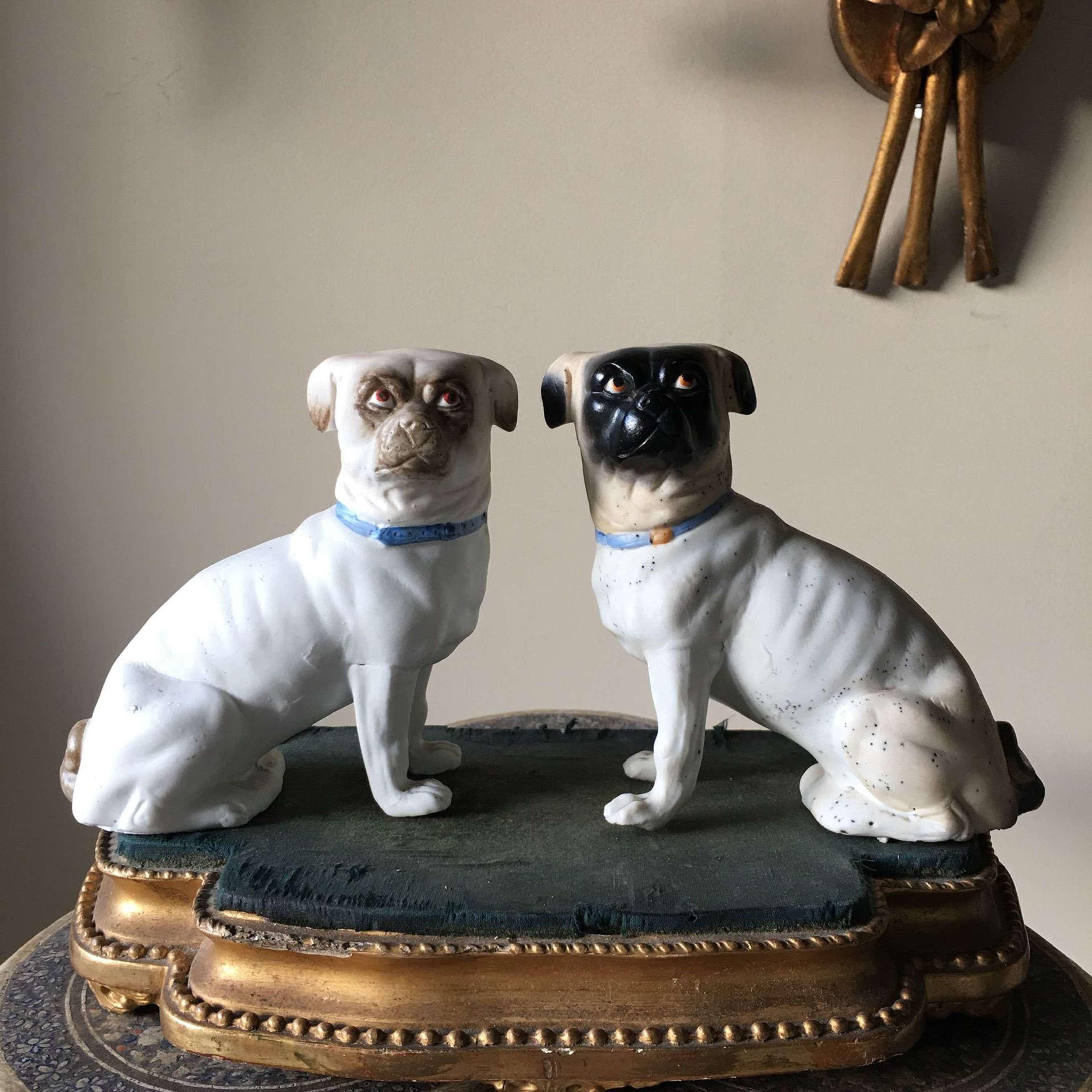 Pair of antique bisque pug ornaments