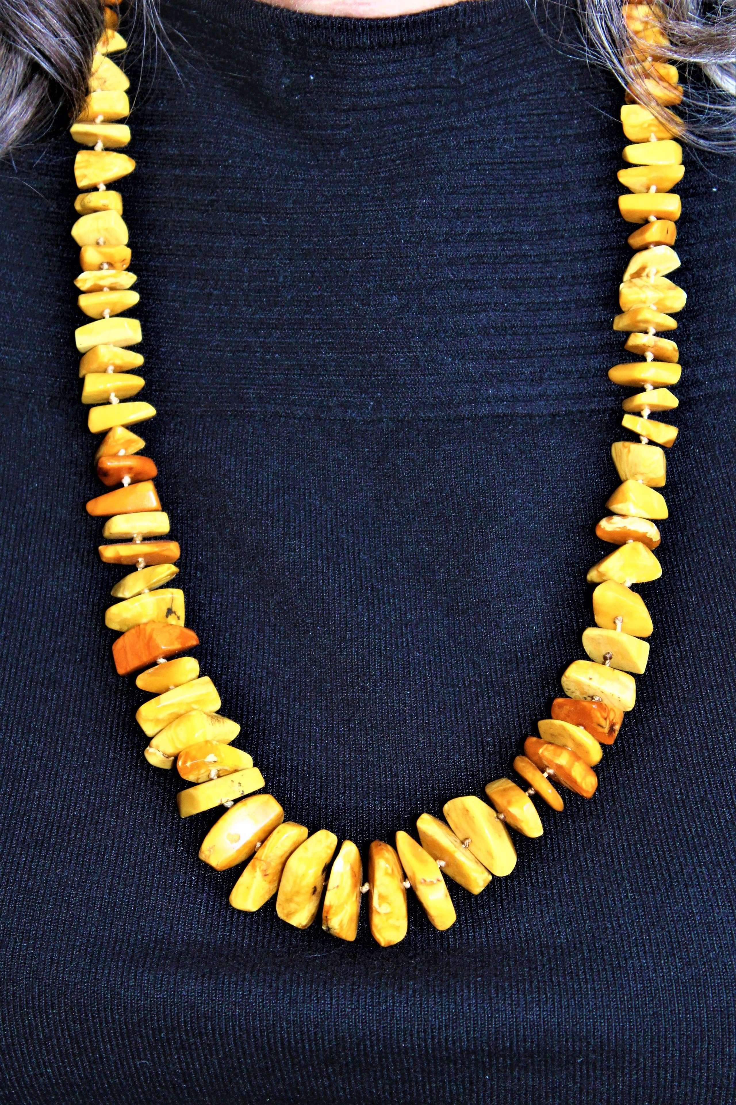An impressive long and very wearable necklace of natural amber
